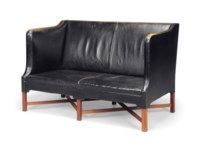 A KAARE KLINT (1888-1954) MAHOGANY AND LEATHER UPHOLSTERED TWO SEATER SOFA