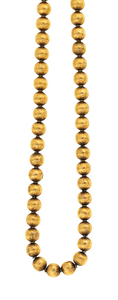A bead necklace and pair of ea