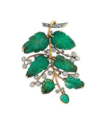 An emerald and diamond brooch,