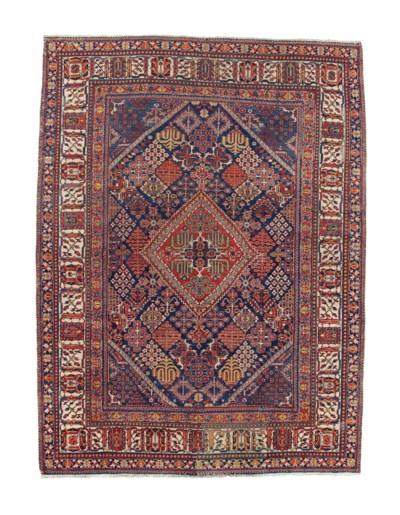 A WEST PERSIAN CARPET