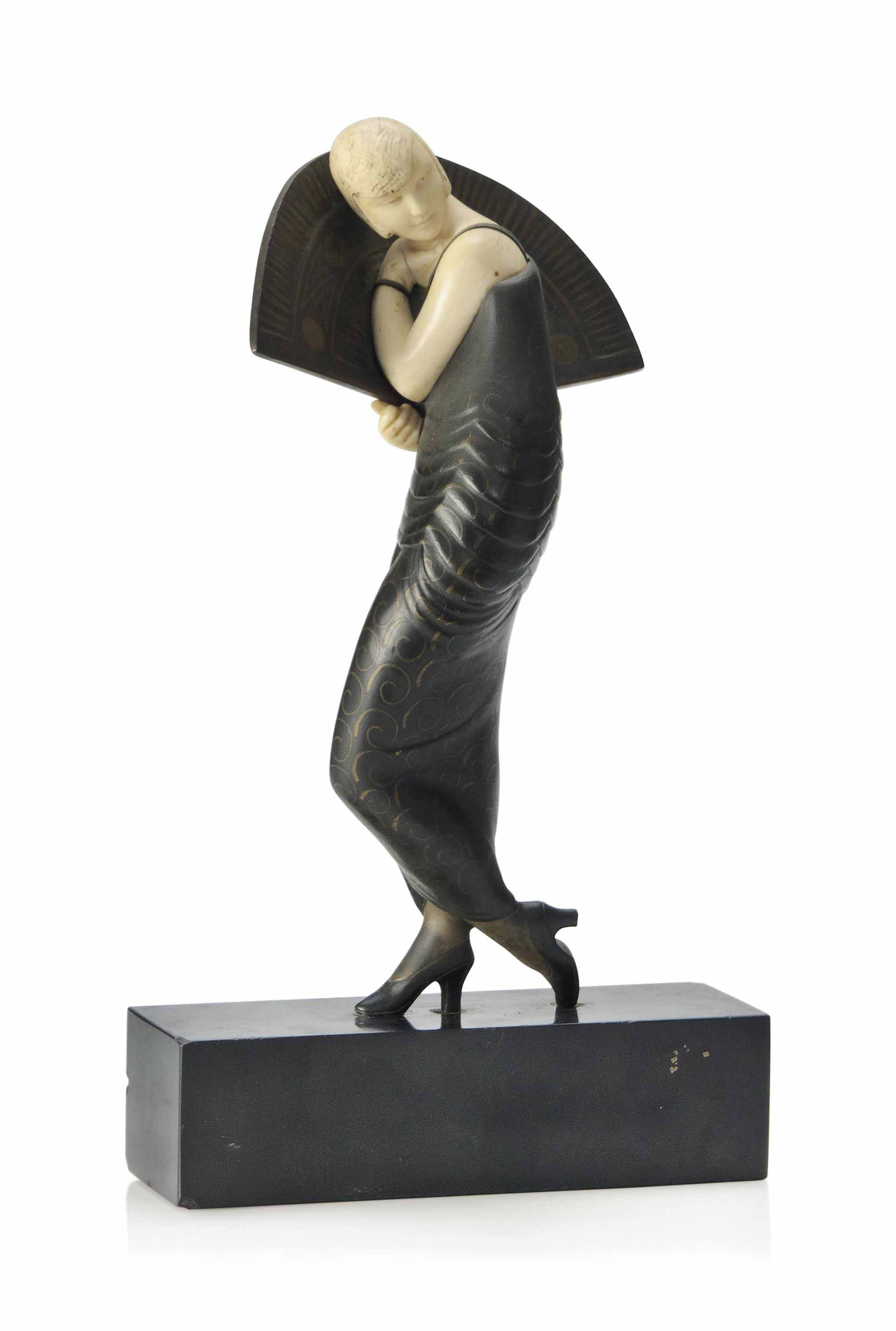AN ALEXANDRE KELETY PATINATED AND COLD-PAINTED BRONZE AND IVORY FIGURE