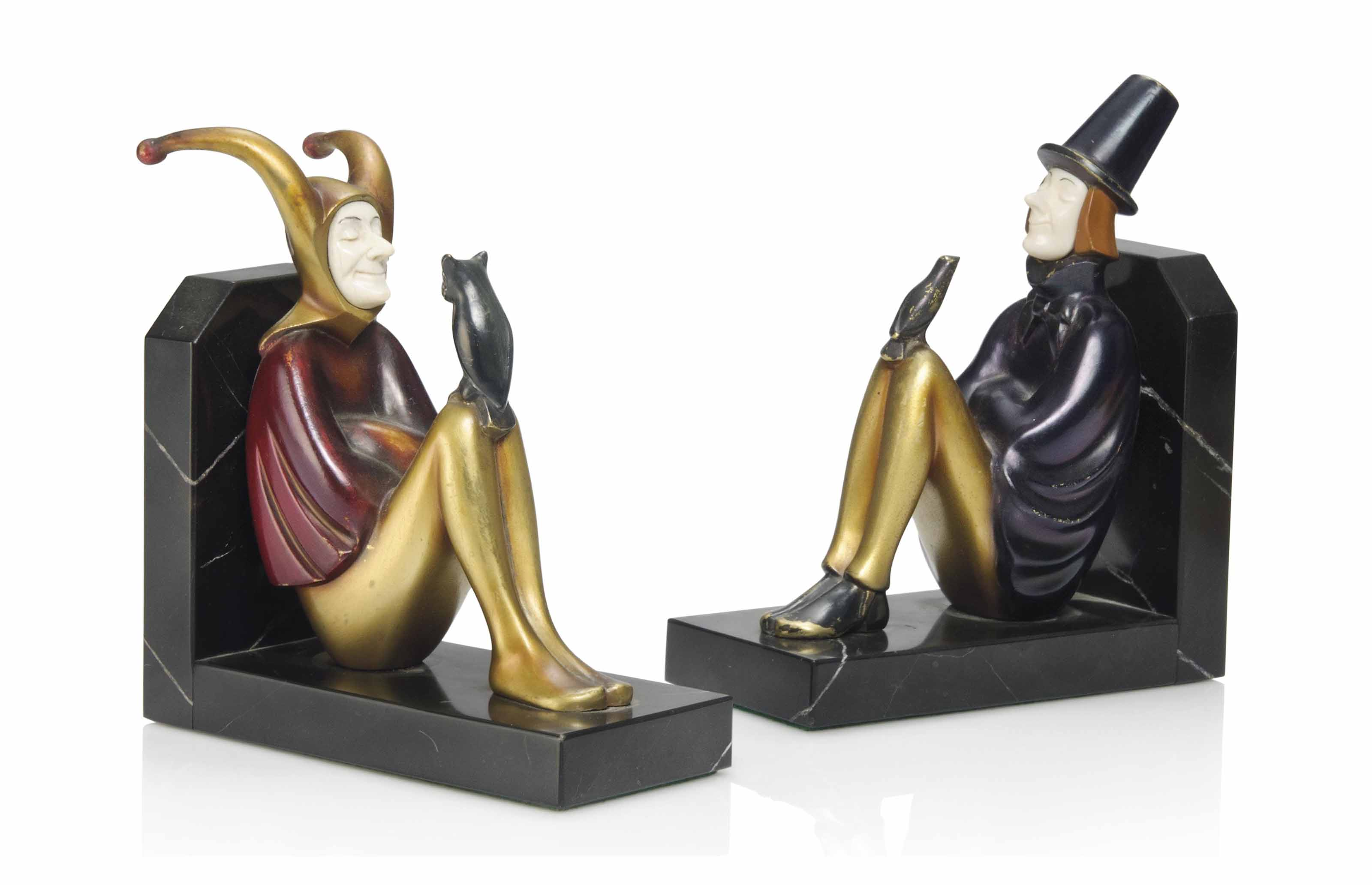 A PAIR OF ROLAND PARIS (1894-1945) COLD-PAINTED BRONZE AND IVORY FIGURAL BOOKENDS
