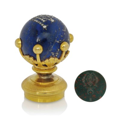A GOLD AND LAPIS LAZULI SEAL W