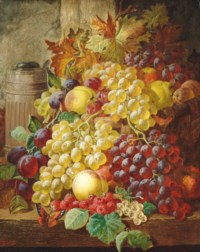 Grapes, plums, apples and raspberries on a wooden ledge