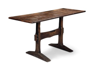 AN OAK TRESTLE TABLE