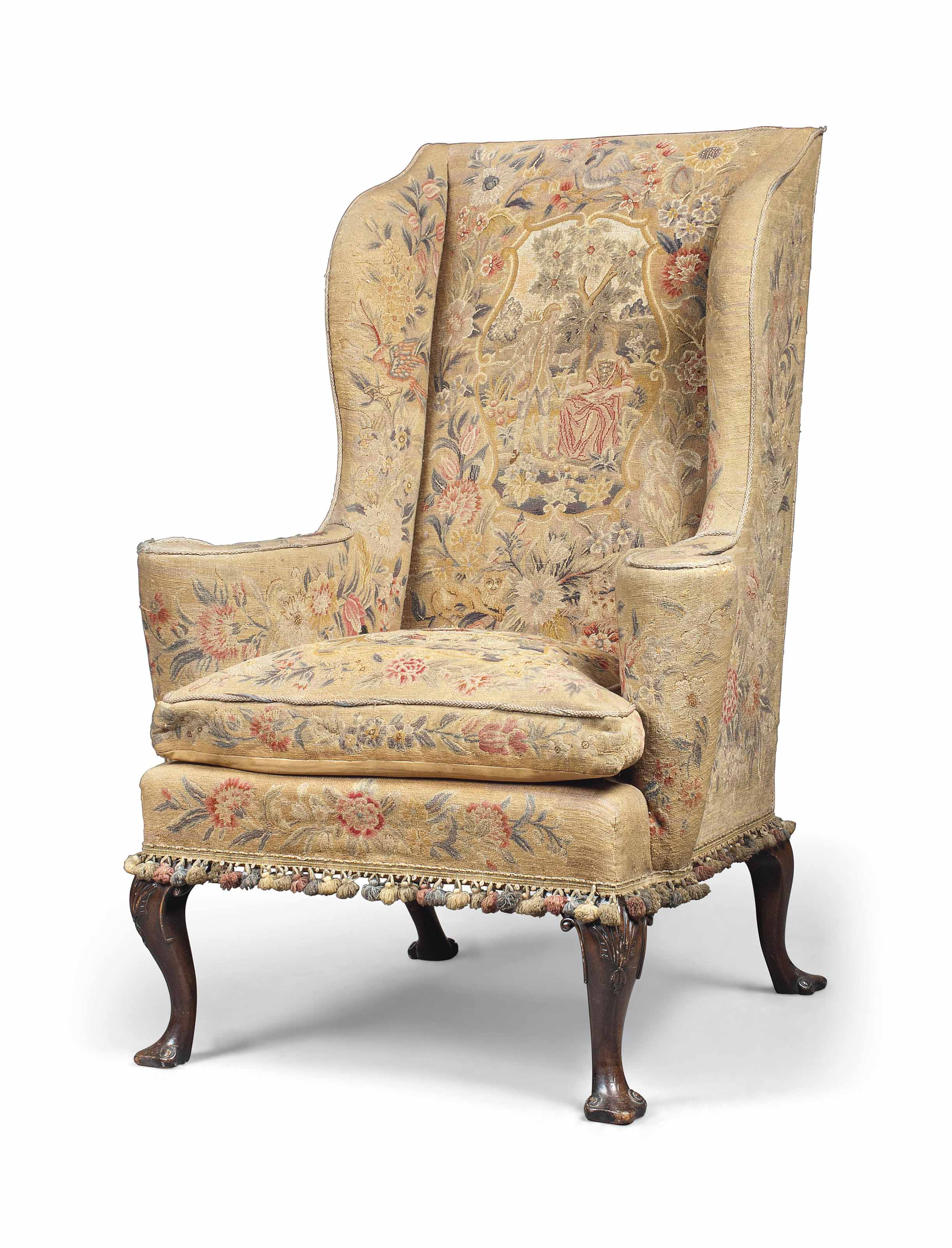 A FLORAL NEEDLEWORK-COVERED WING ARMCHAIR