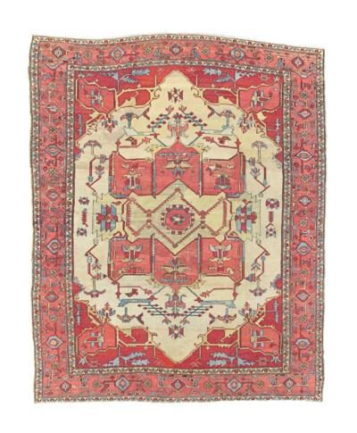 An antique Serapi carpet