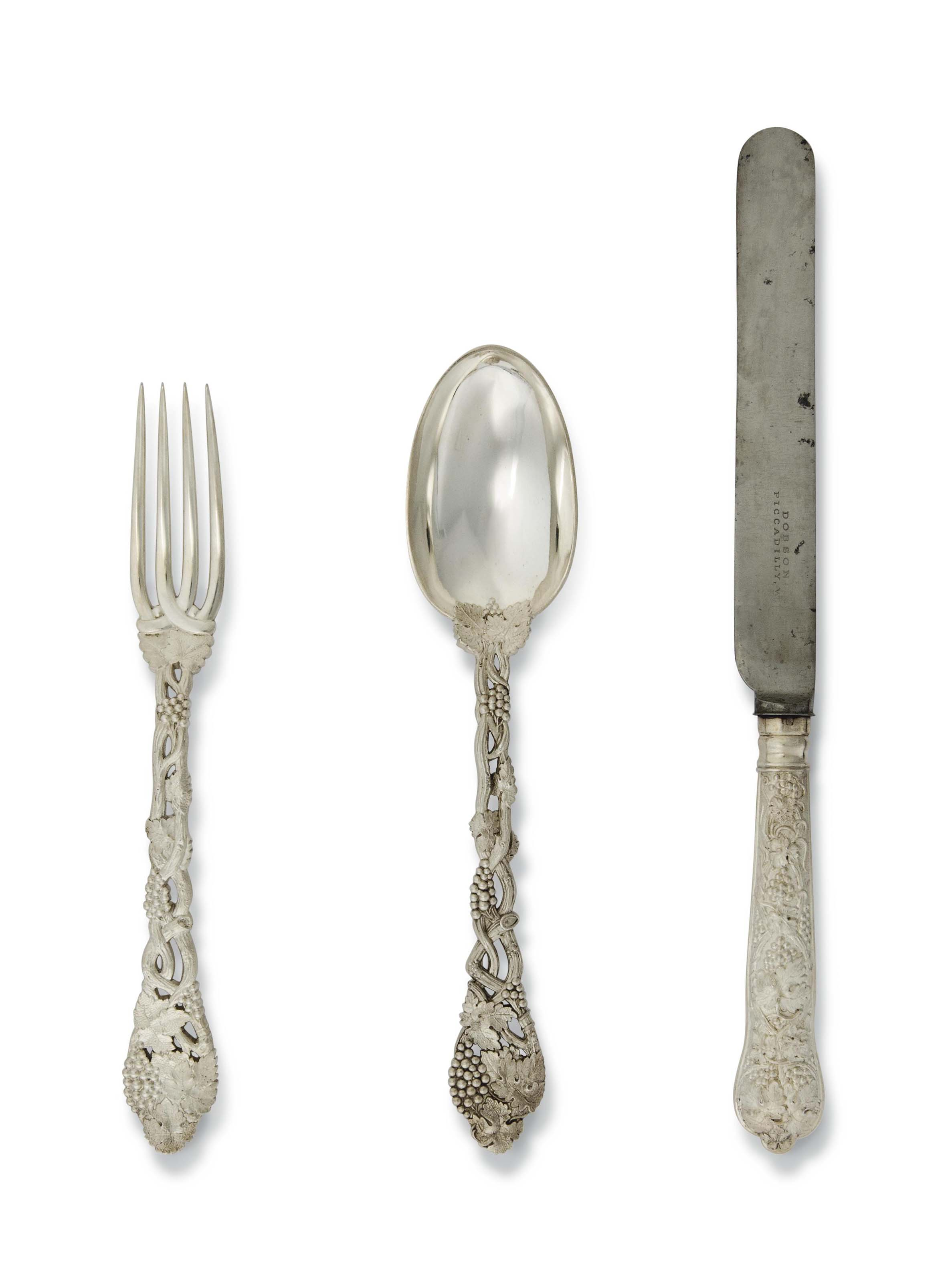 AN EDWARDIAN SILVER TABLE SERVICE OF OPENWORK GRAPEVINE PATTERN
