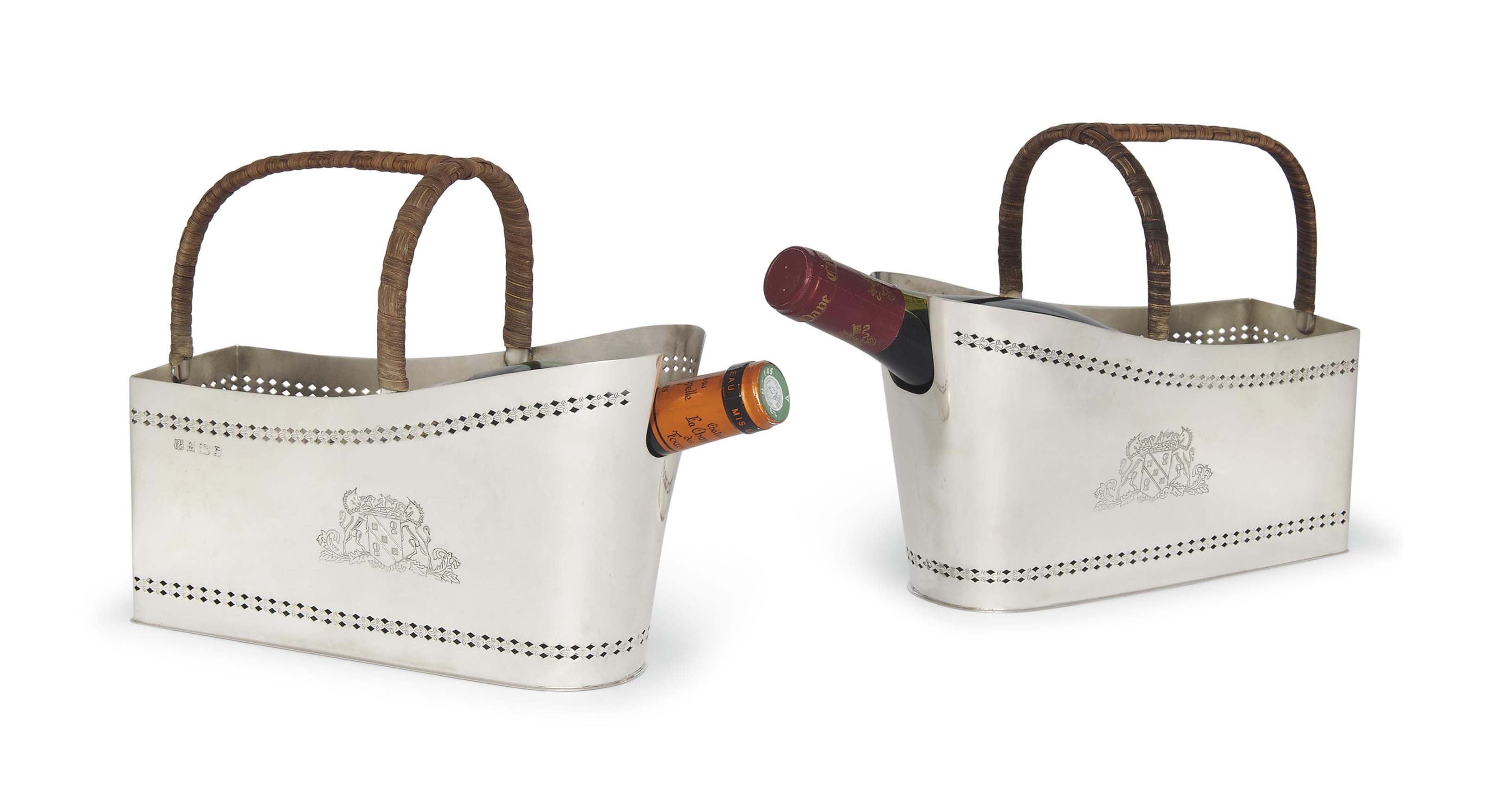 A PAIR OF SILVER BOTTLE HOLDER