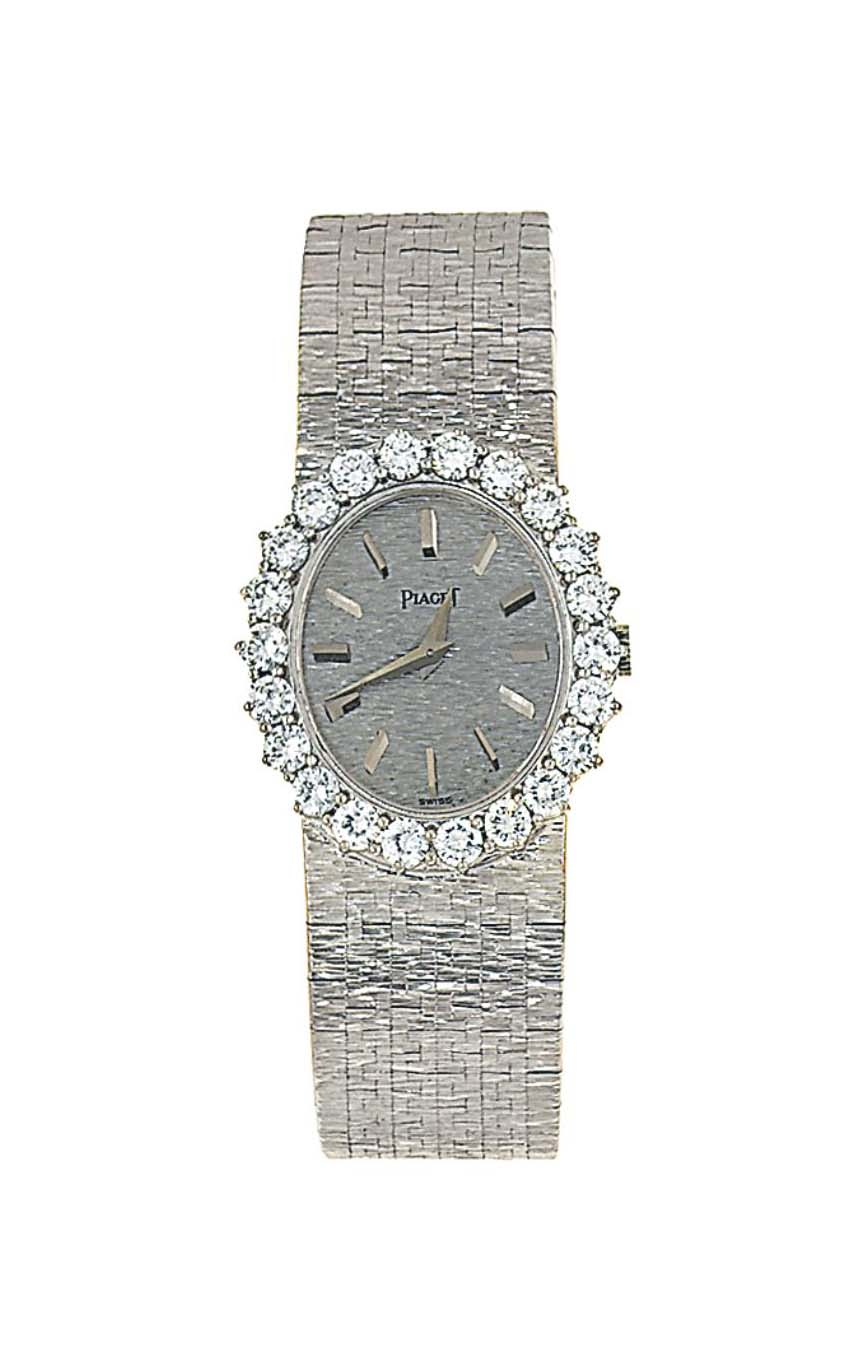 A diamond-set wristwatch, by P