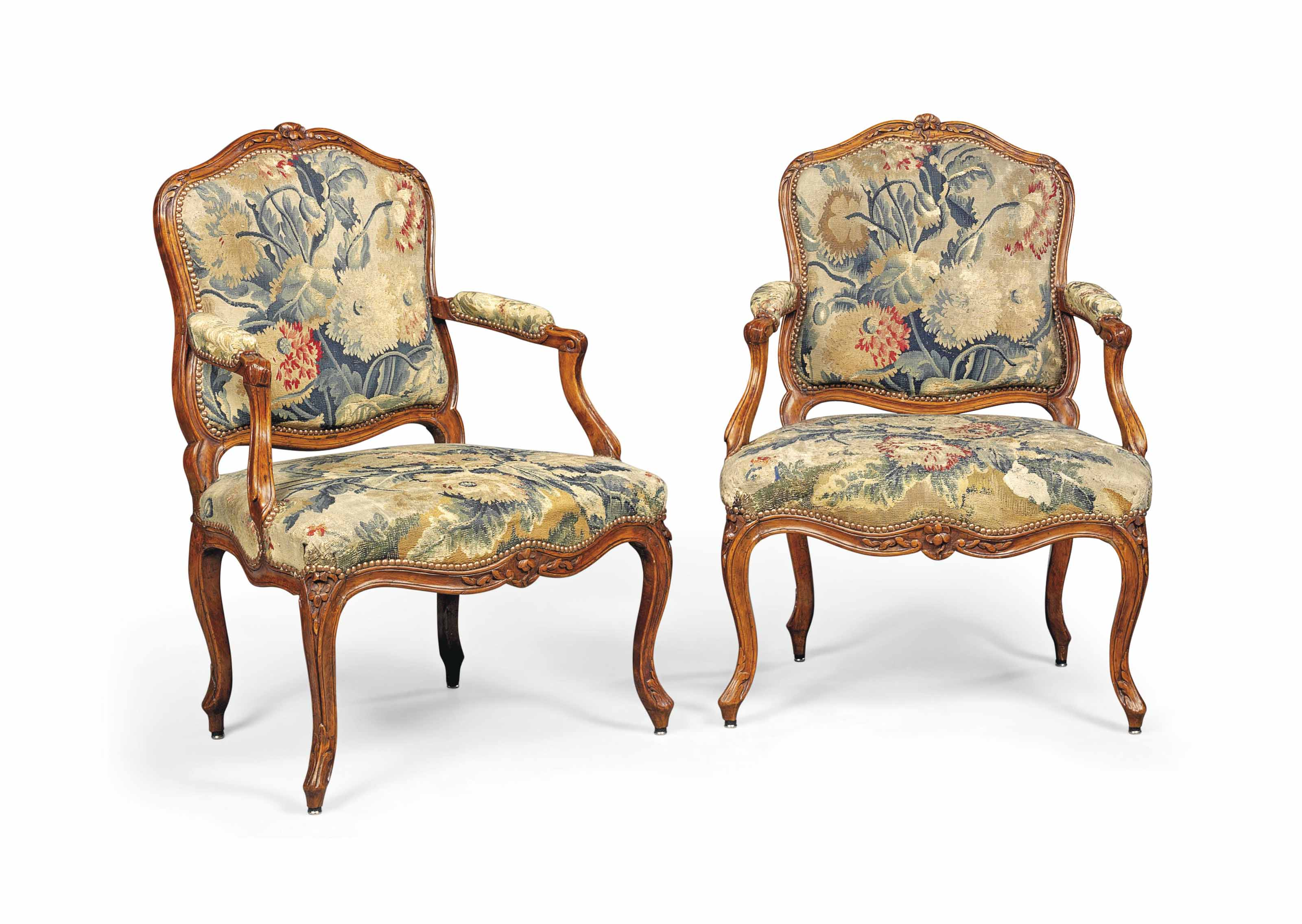 A PAIR OF LOUIS XV BEECHWOOD ARMCHAIRS