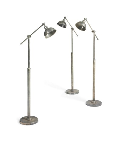 A SET OF THREE PATINATED STEEL