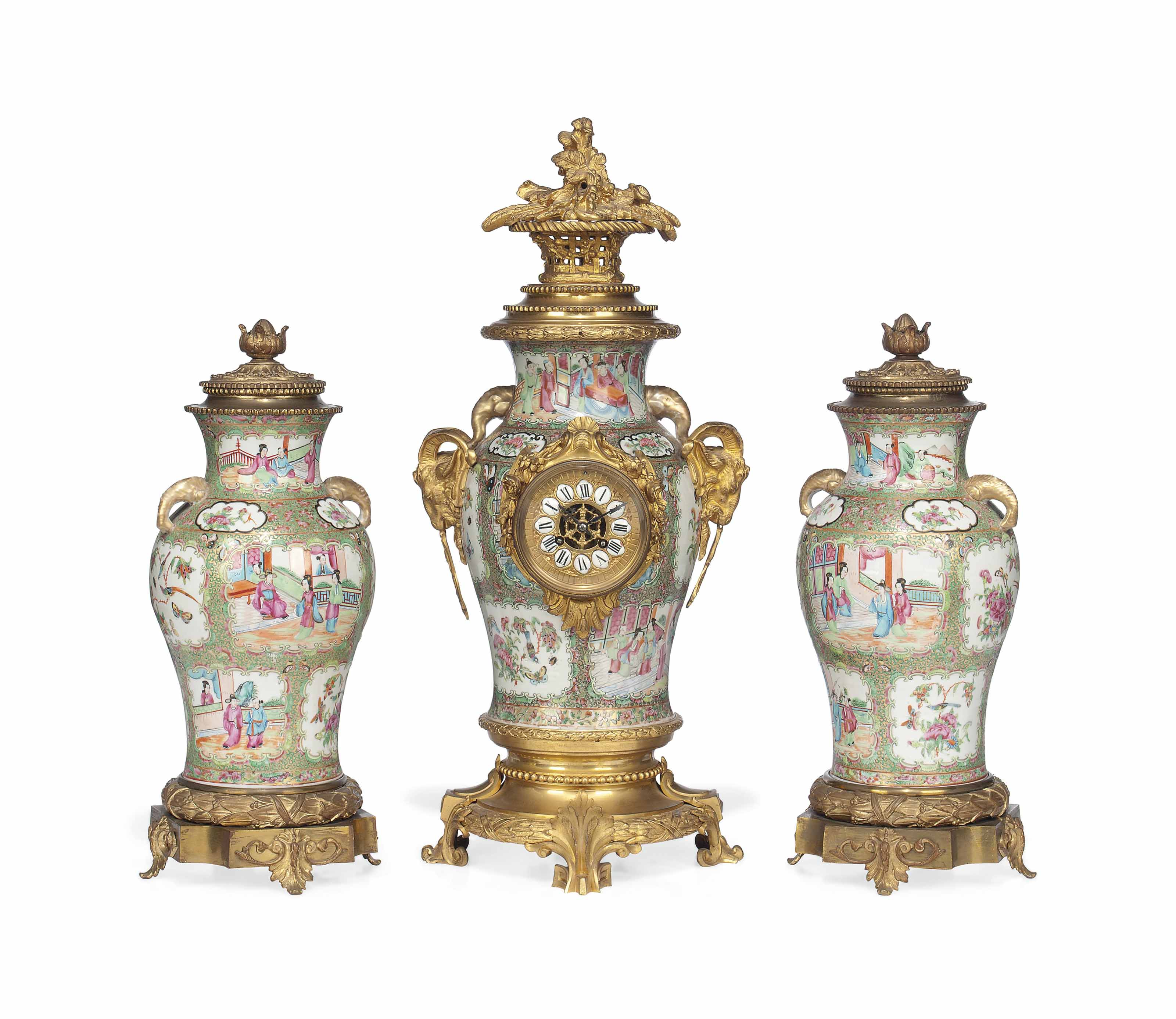 A MATCHED FRENCH ORMOLU-MOUNTED CANTON PORCELAIN STRIKING CLOCK GARNITURE
