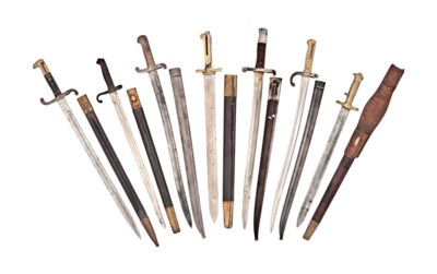 A GROUP OF TWENTY SWORD BAYONE