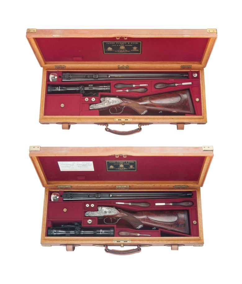 A magnificent new & unused pair of Coggan engraved special large scroll self-opening sidelock ejector double rifles respectively chambered for .470 (nitro express) and .300 (h & h magnum), J. Purdey & Sons, London, England, serial No. 28988-1 & 28988-2. Sold for £152,500 on 15 December 2014 at Christie's in London