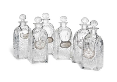 SIX CUT-GLASS SPIRIT DECANTERS