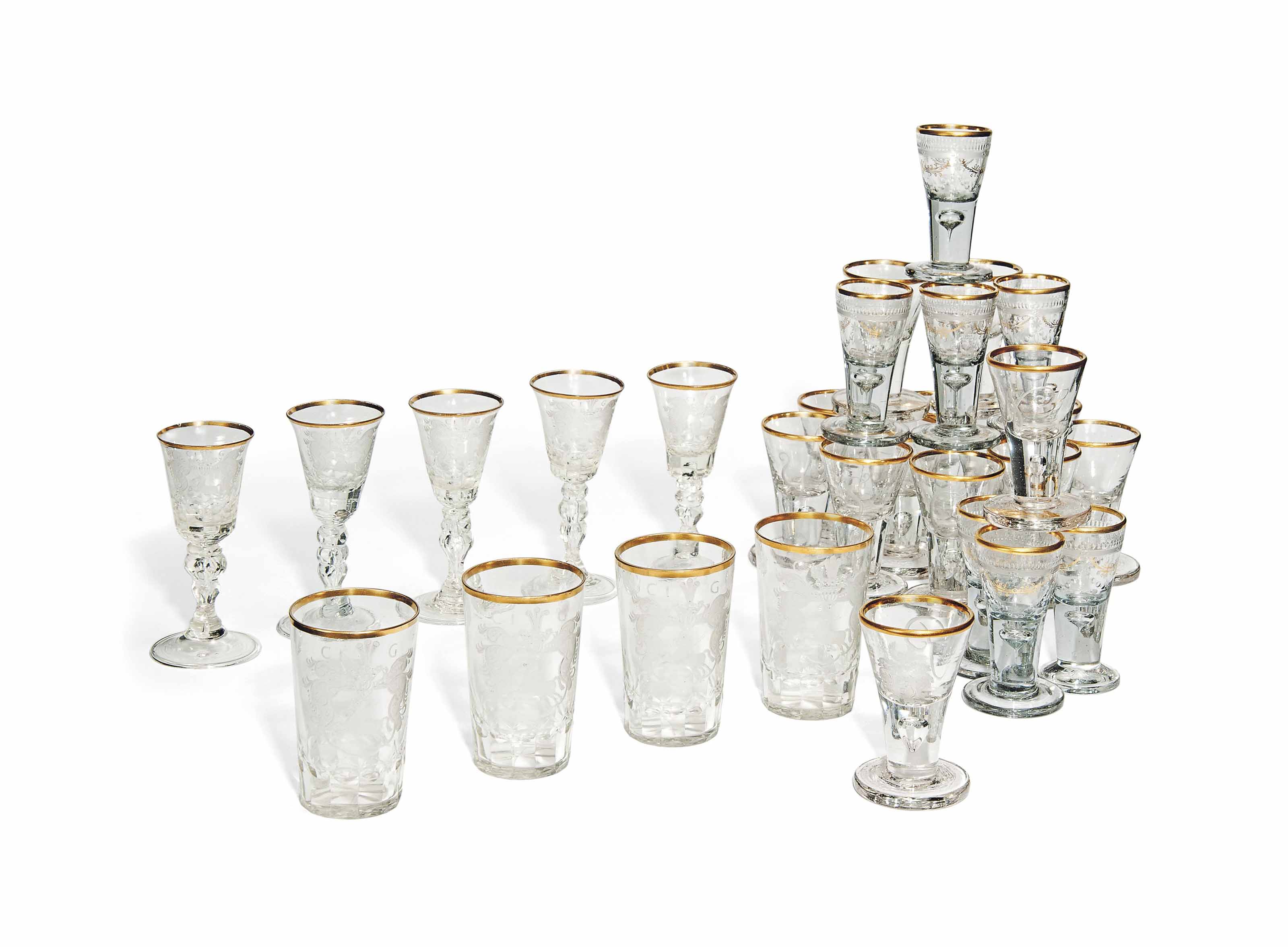 A SET OF FIVE SILESIAN ENGRAVED WINE GLASSES AND FOUR BEAKERS