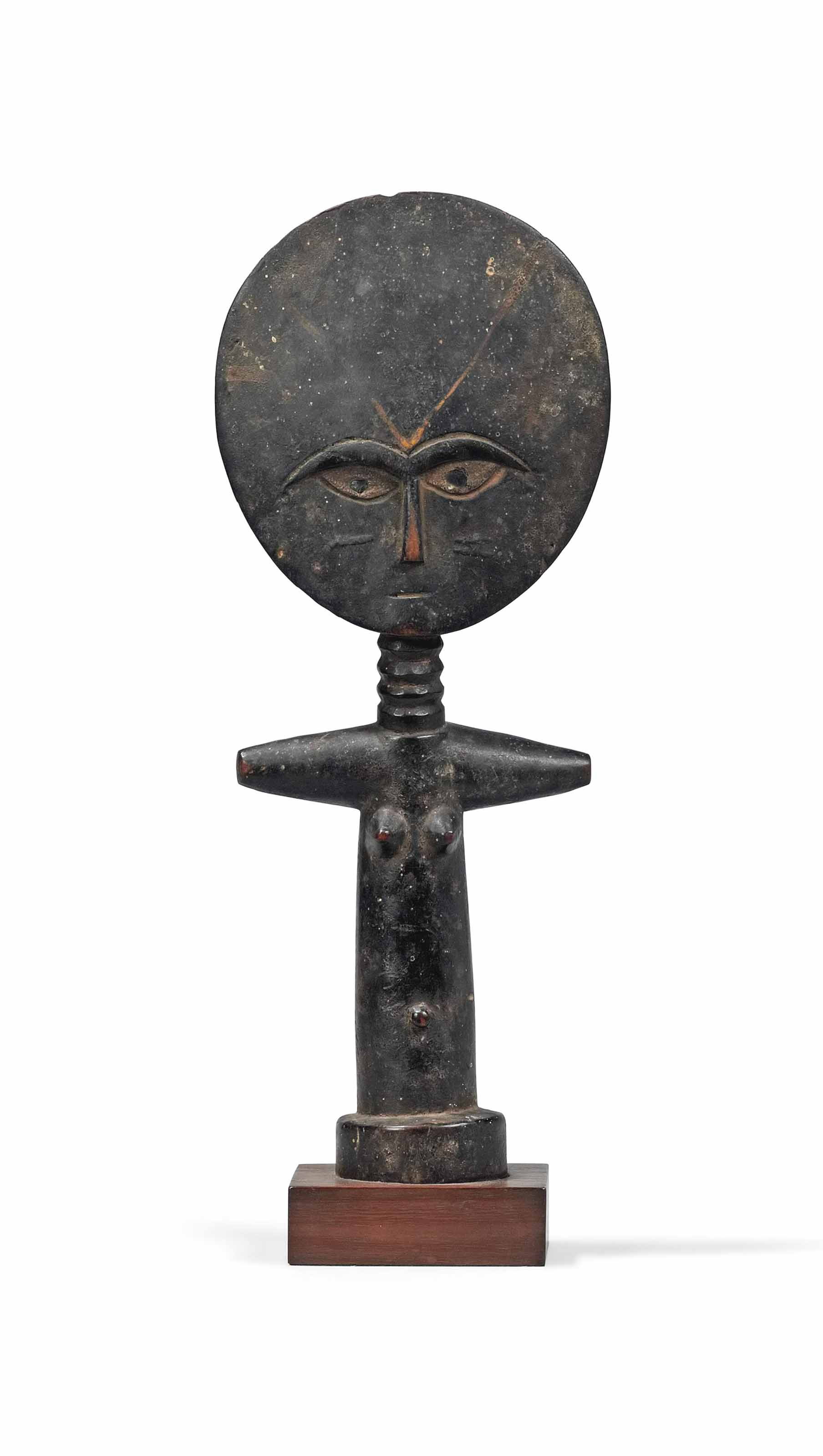 AN ASHANTI WOODEN FIGURE, AKU'