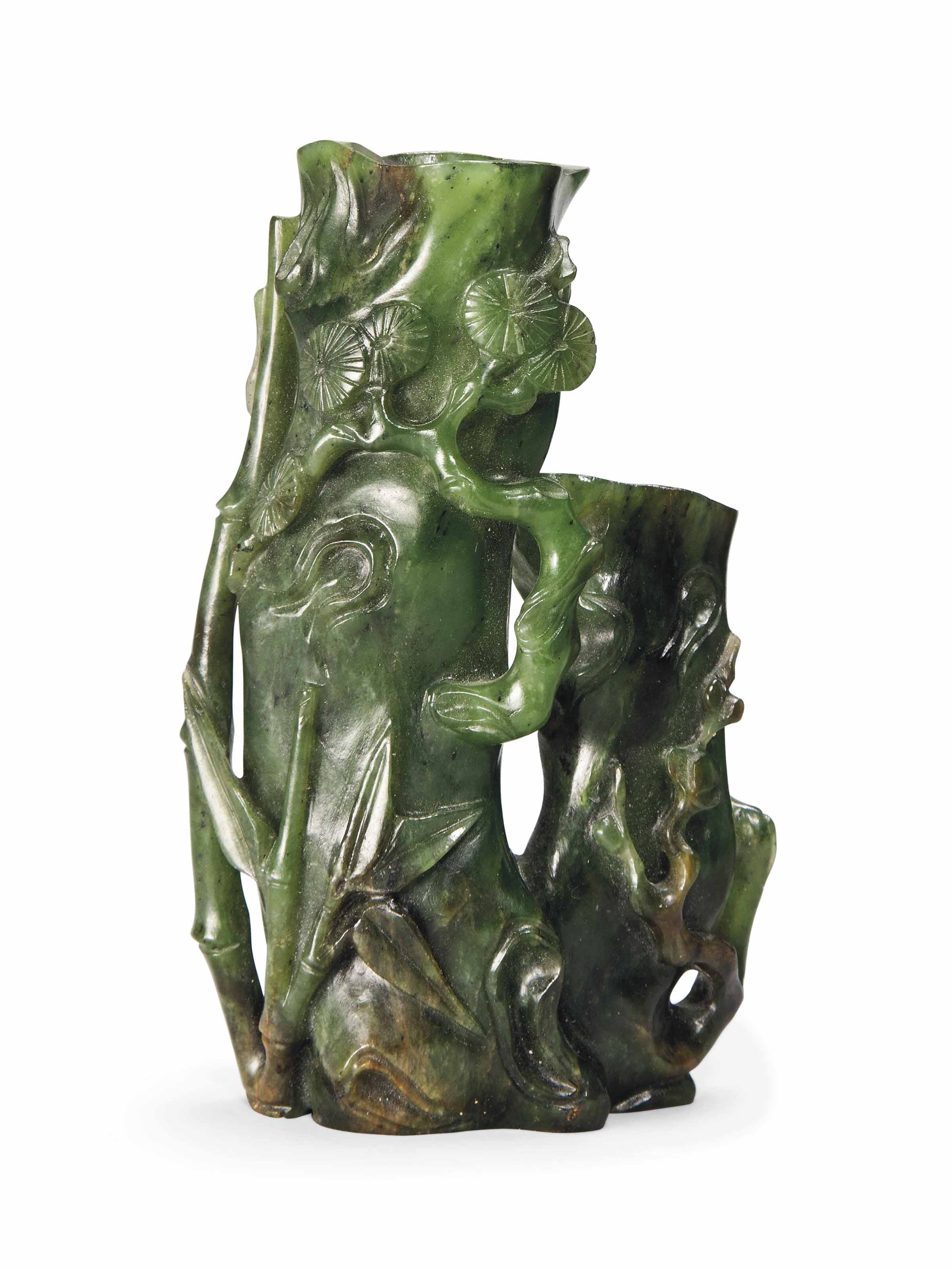 A CHINESE SPINACH-GREEN JADE VASE