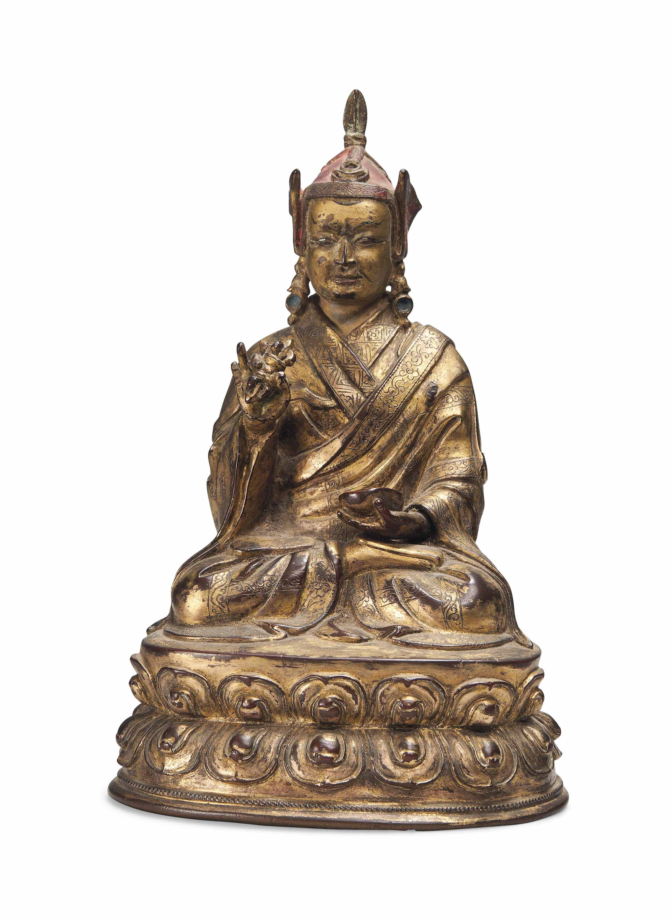 A CHINESE GILT BRONZE MODEL OF A LAMA