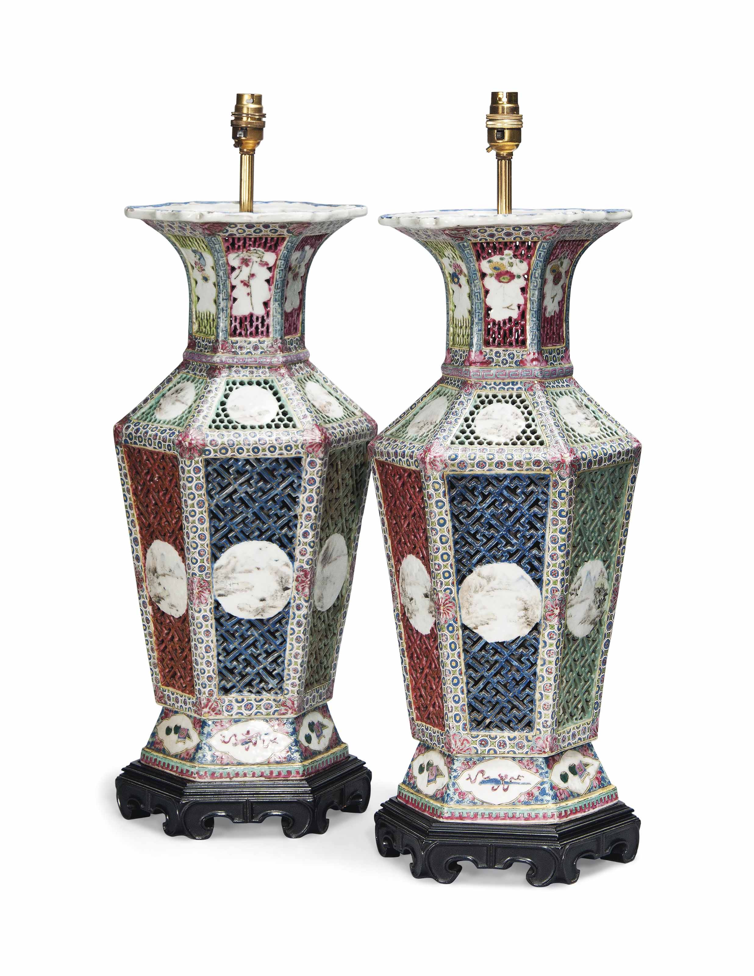 A PAIR OF CHINESE FAMILLE ROSE RETICULATED HEXAGONAL BALUSTER VASES