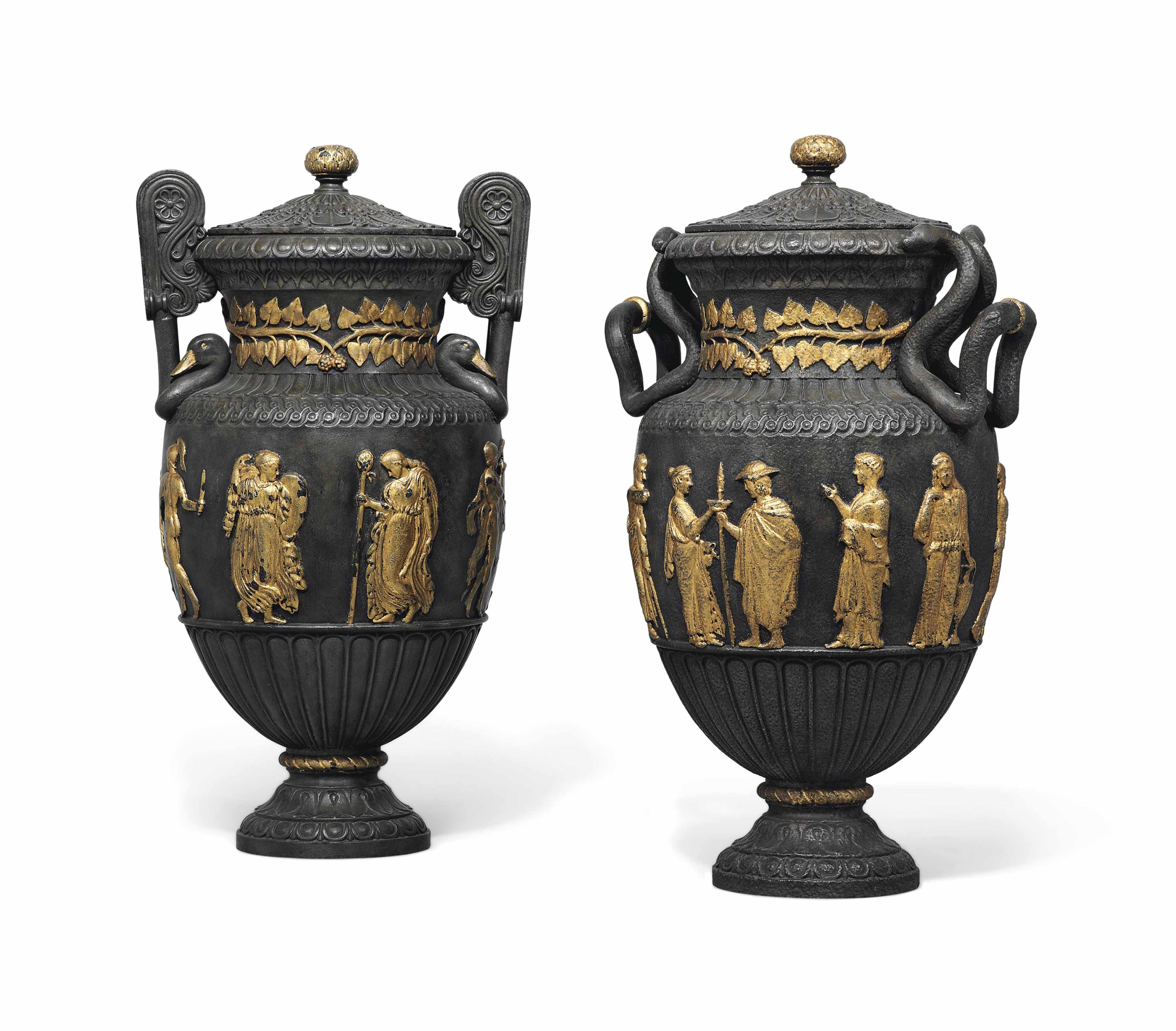 A NEAR PAIR OF PARCEL-GILT AND PATINATED CAST-IRON VASES