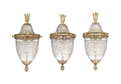 THREE GILT-BRONZE AND CUT-GLAS