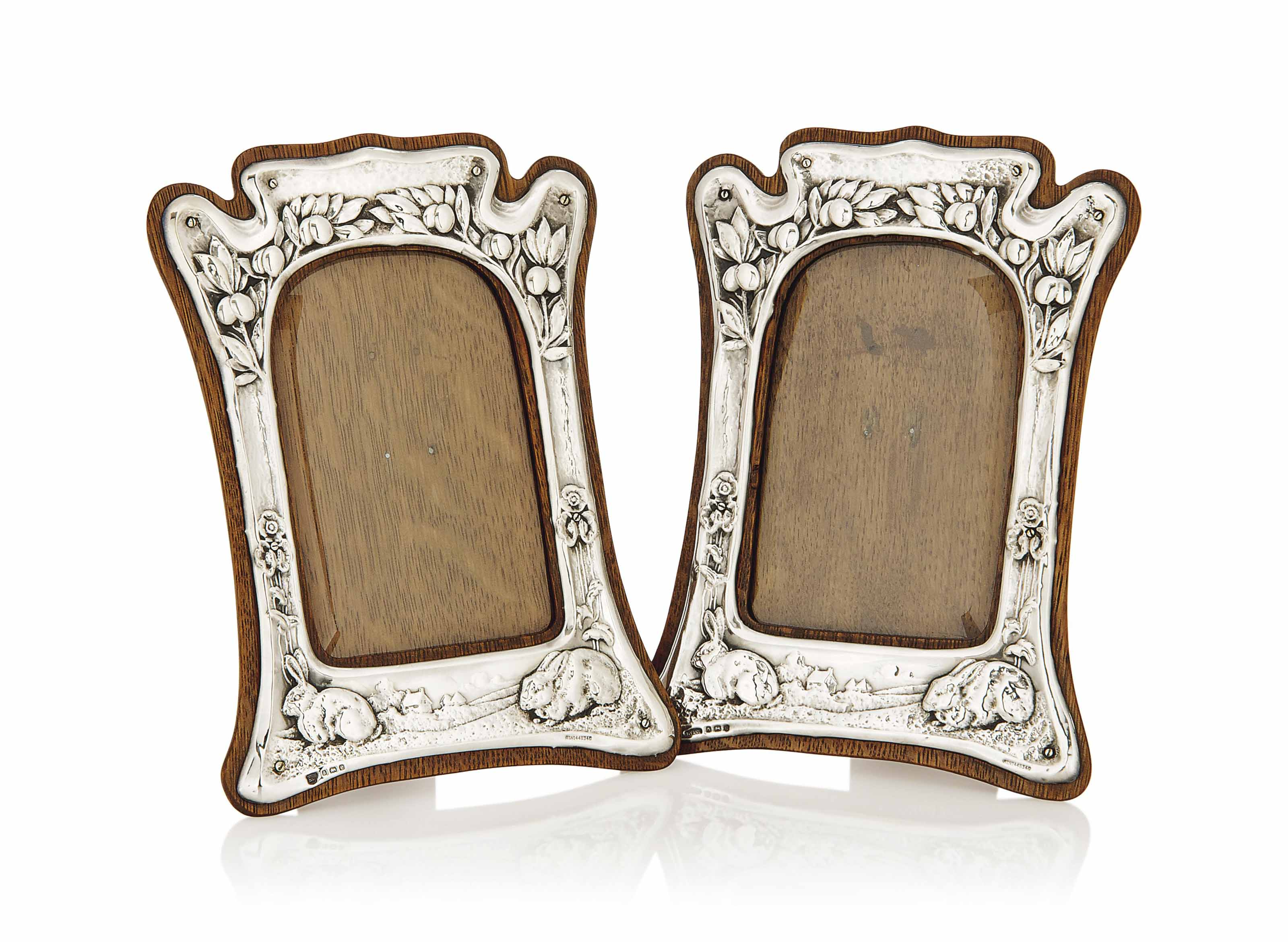 A MATCHED PAIR OF SILVER AND OAK PHOTOGRAPH FRAMES BY JAMES DEAKIN & SONS AND GOURDEL VALES & CO
