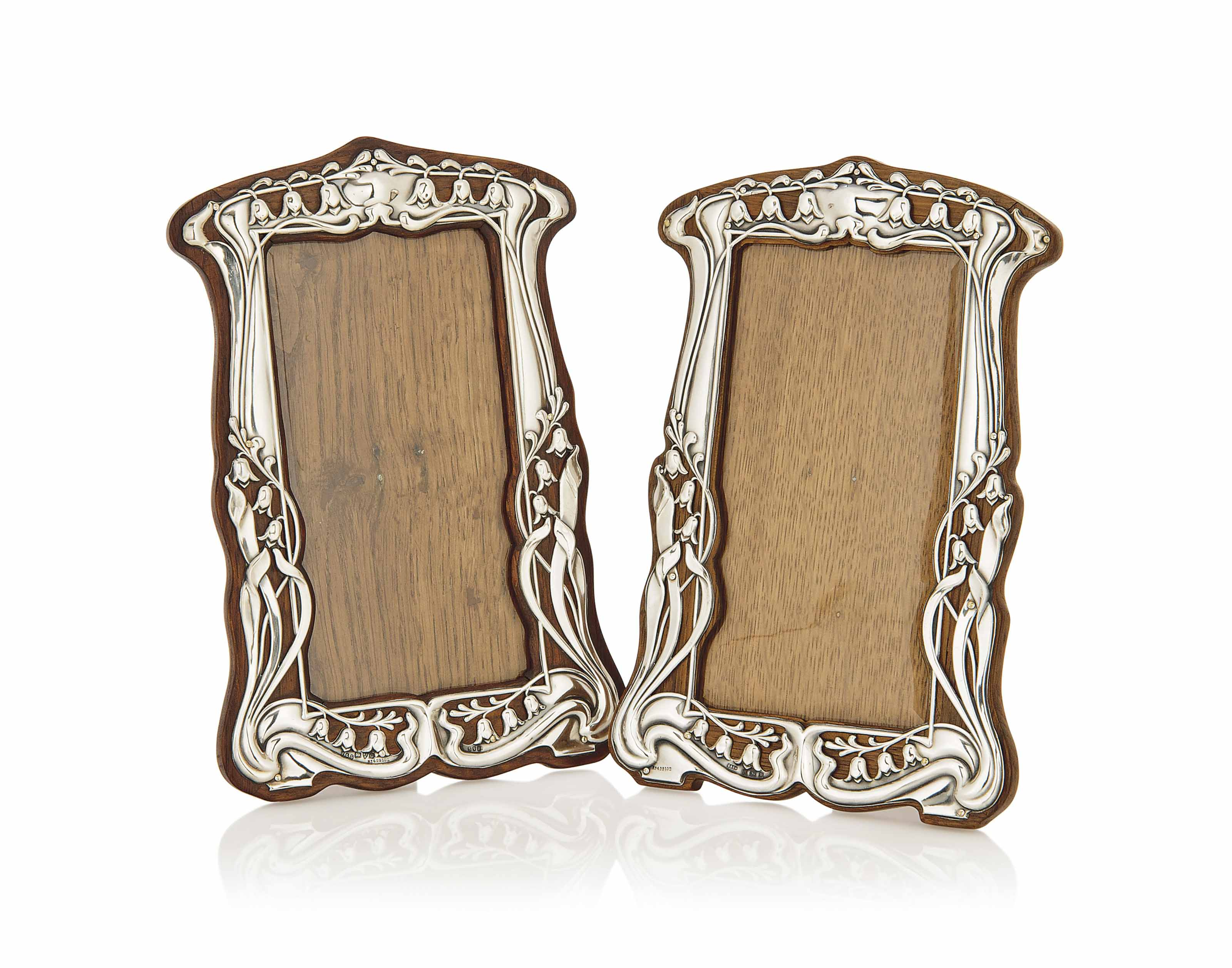 A MATCHED PAIR OF SILVER AND OAK PHOTOGRAPH FRAMES BY T & S AND SYDNEY & CO