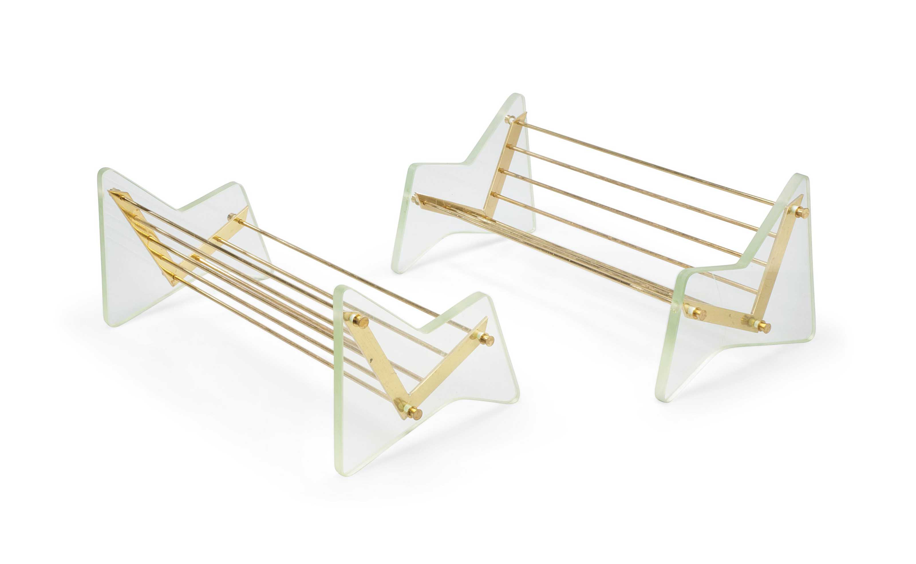A PAIR OF FONTANA ARTE GLASS AND BRASS TABLE BOOK STANDS