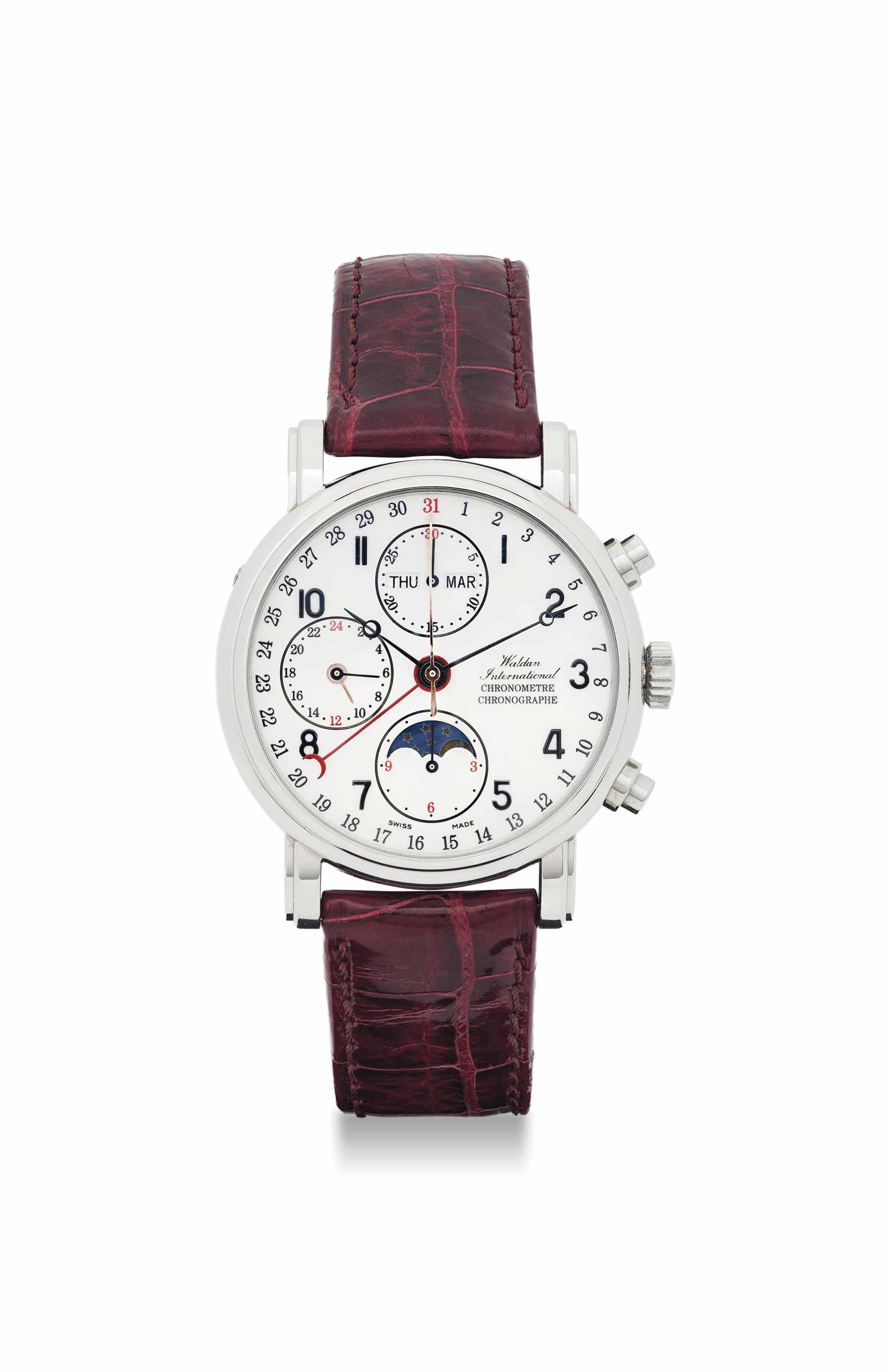 WALDAN INTERNATIONAL. A PLATINUM AUTOMATIC TRIPLE CALENDAR CHRONOGRAPH WRISTWATCH WITH MOON PHASES