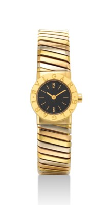 BULGARI. A LADY'S 18K THREE-CO