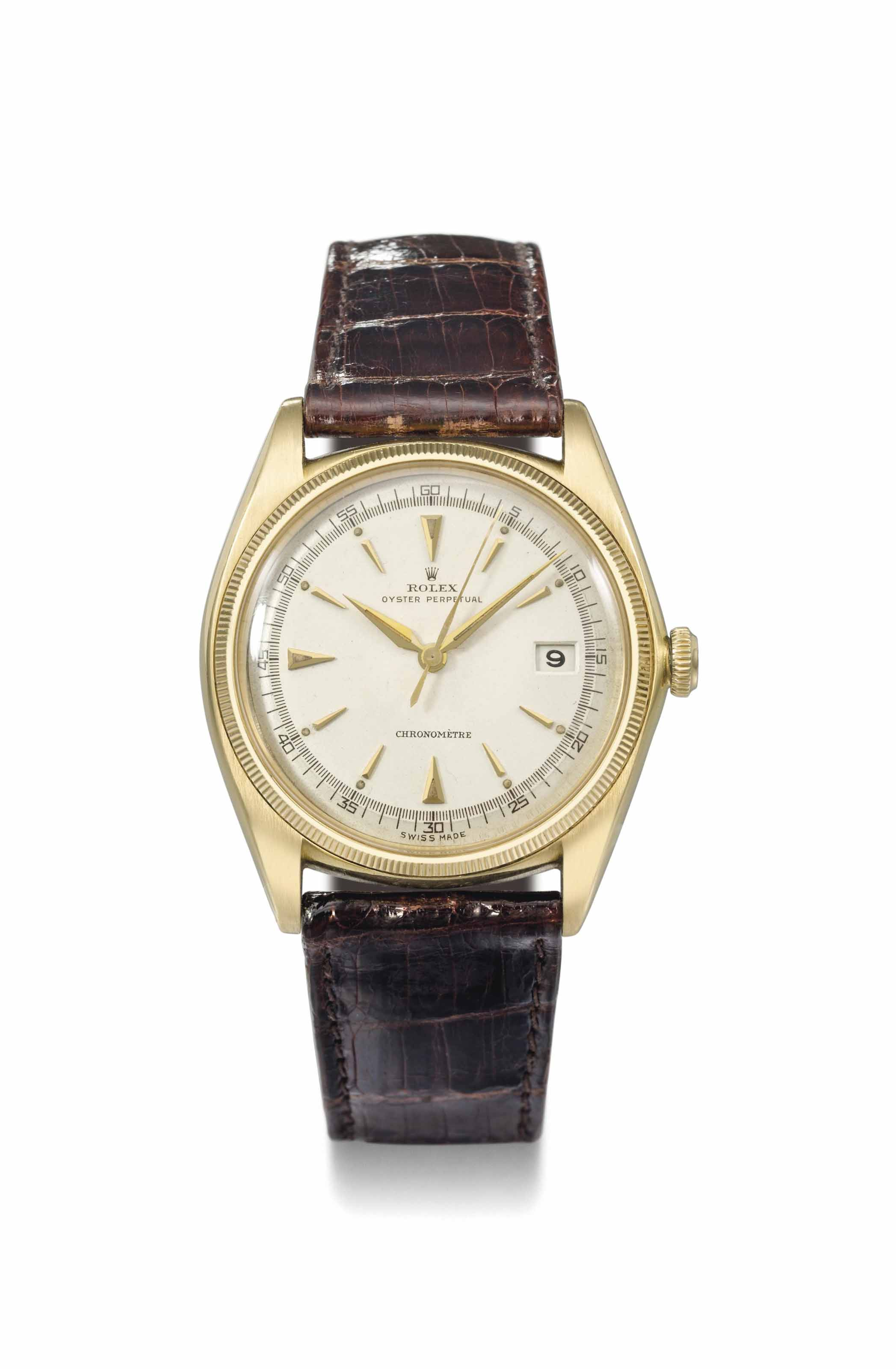 Rolex. A fine and rare 18k gold automatic wristwatch with sweep centre seconds and date
