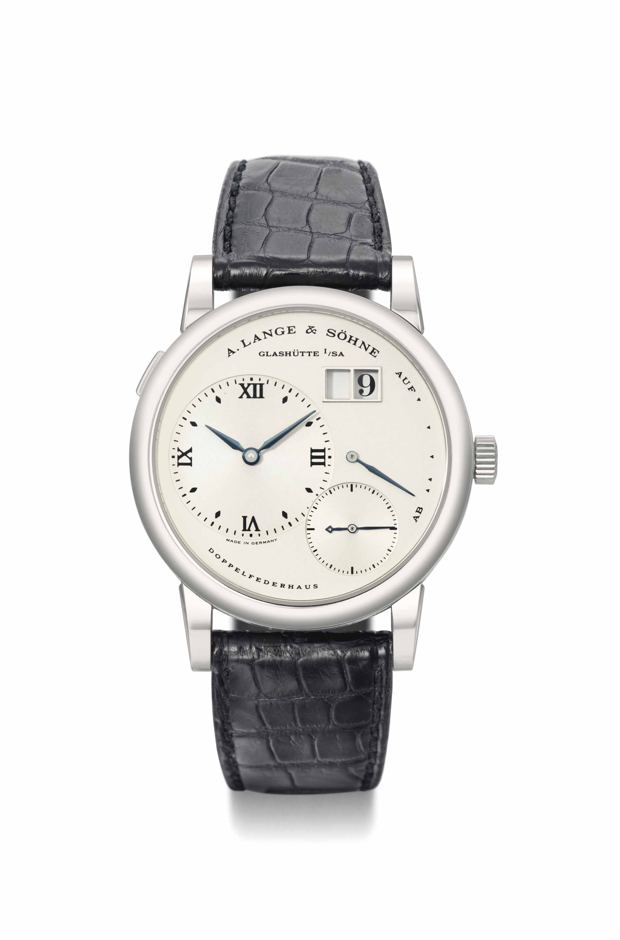 A. Lange & Söhne. A highly limited and very attractive stainless steel twin-barrel wristwatch with oversized date and power reserve