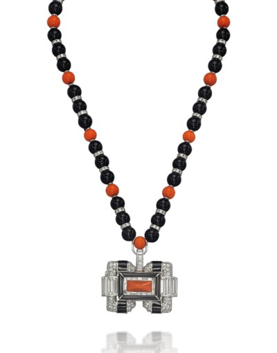 A CORAL, ONYX AND DIAMOND NECK