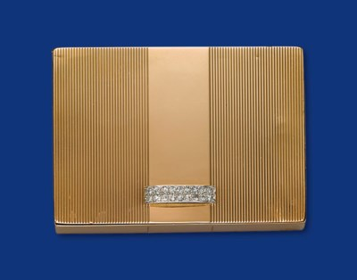 A GOLD AND DIAMOND COMPACT, BY