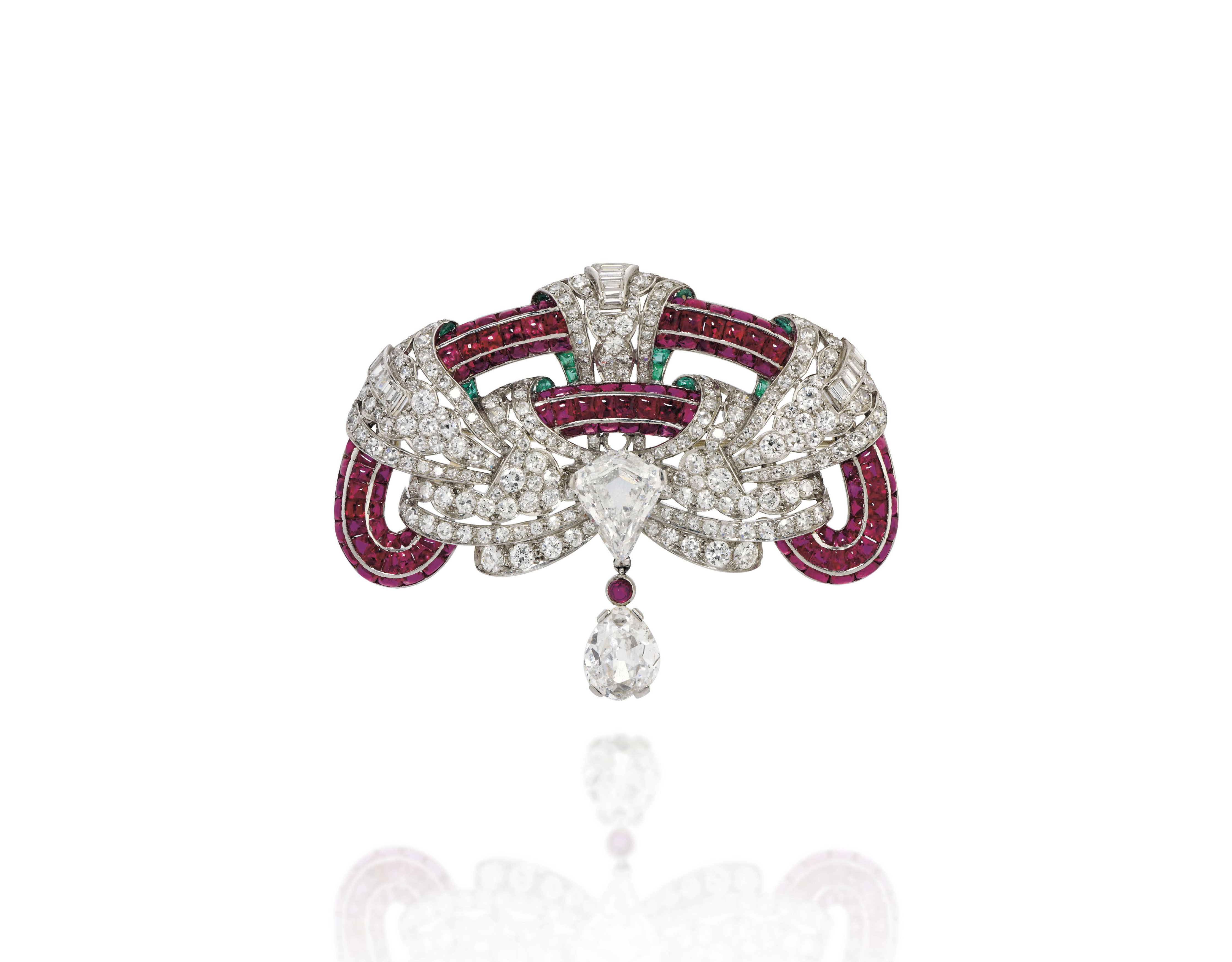 AN ART DECO RUBY, EMERALD AND DIAMOND BROOCH, BY JANESICH