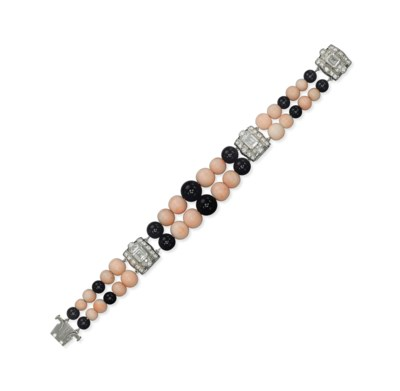 AN ART DECO ONYX, CORAL AND DI