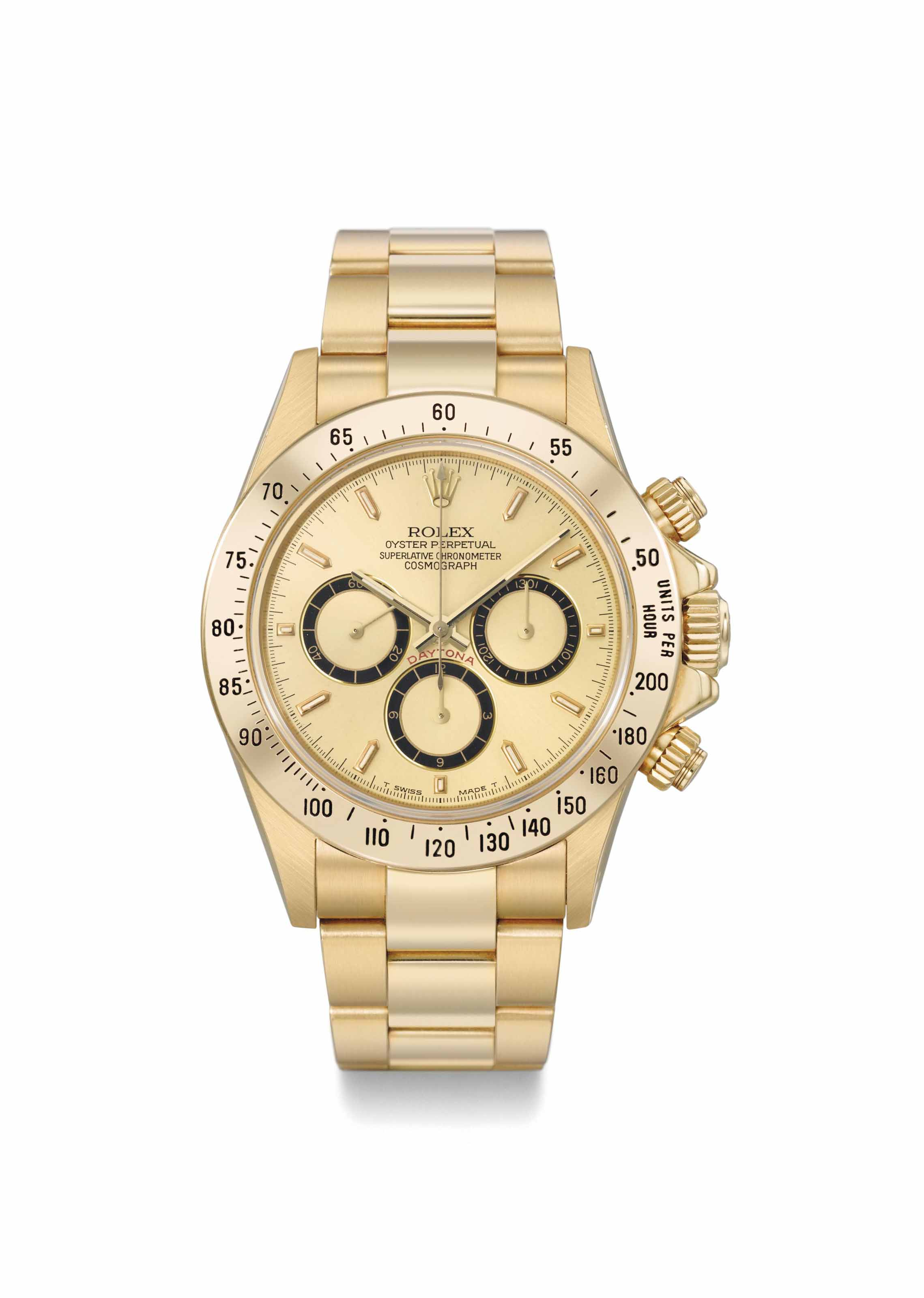 Rolex. An early and highly attractive 18K gold automatic chronograph wristwatch with four lines dial and bracelet