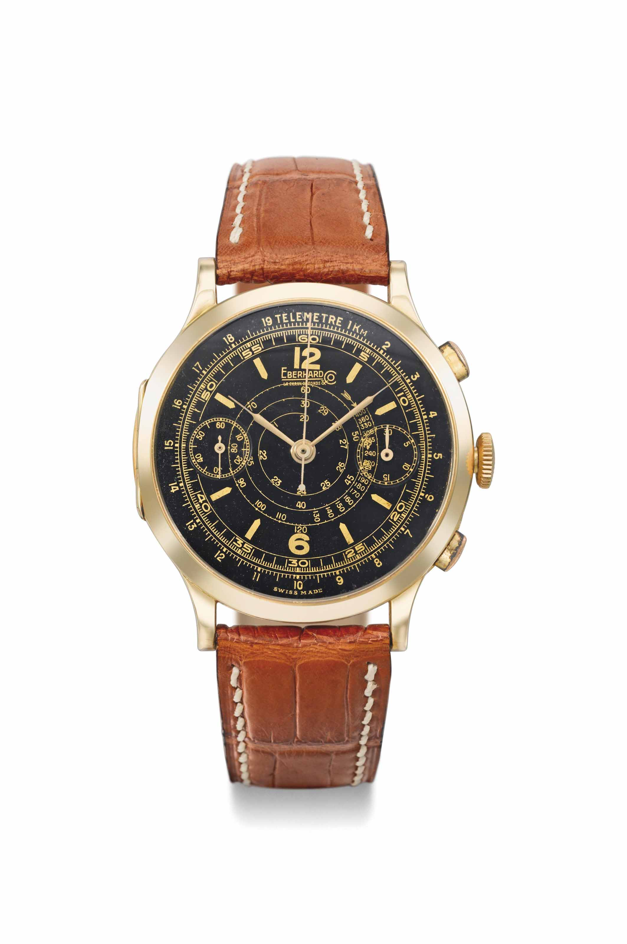 Eberhard. A fine and unusual oversized 18K gold hinged chronograph wristwatch with black dial