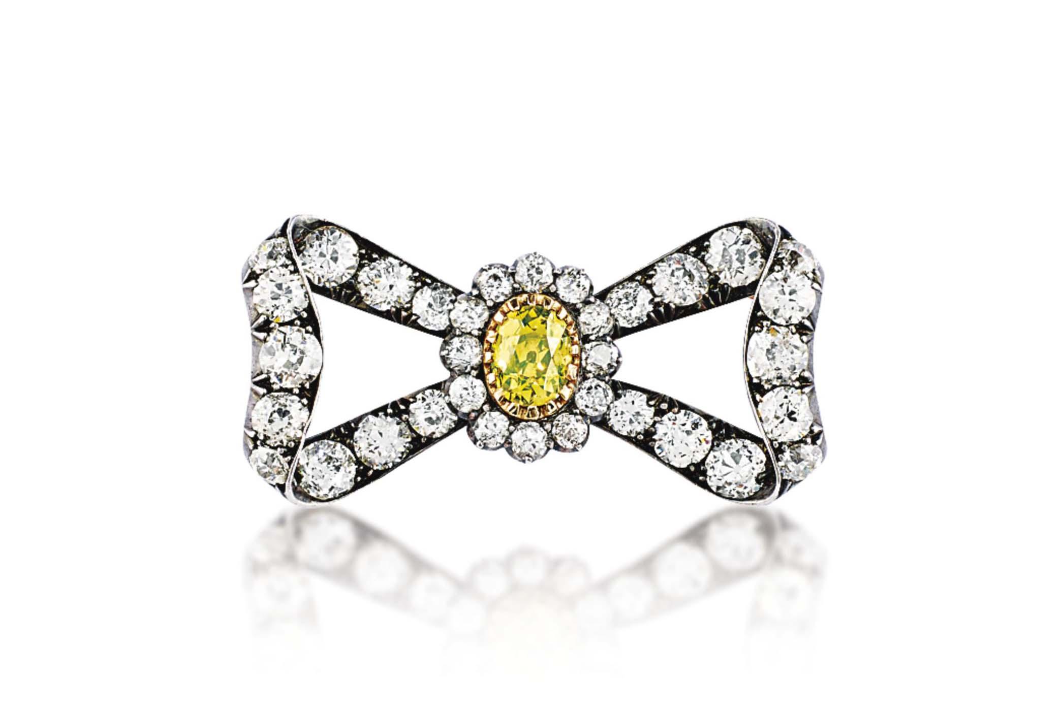 A 19TH CENTURY COLOURED DIAMON