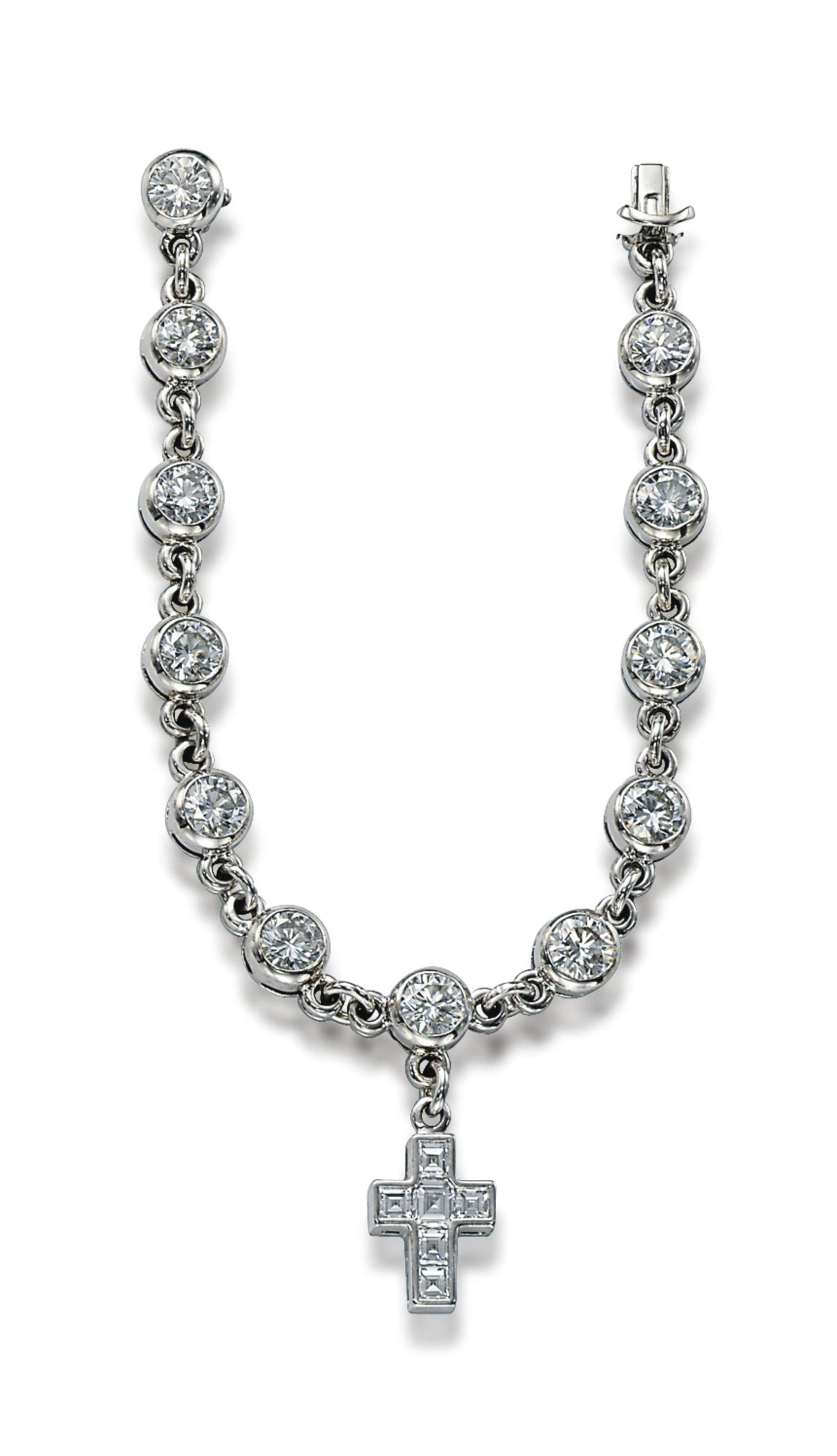 A DIAMOND CHARM BRACELET, BY G