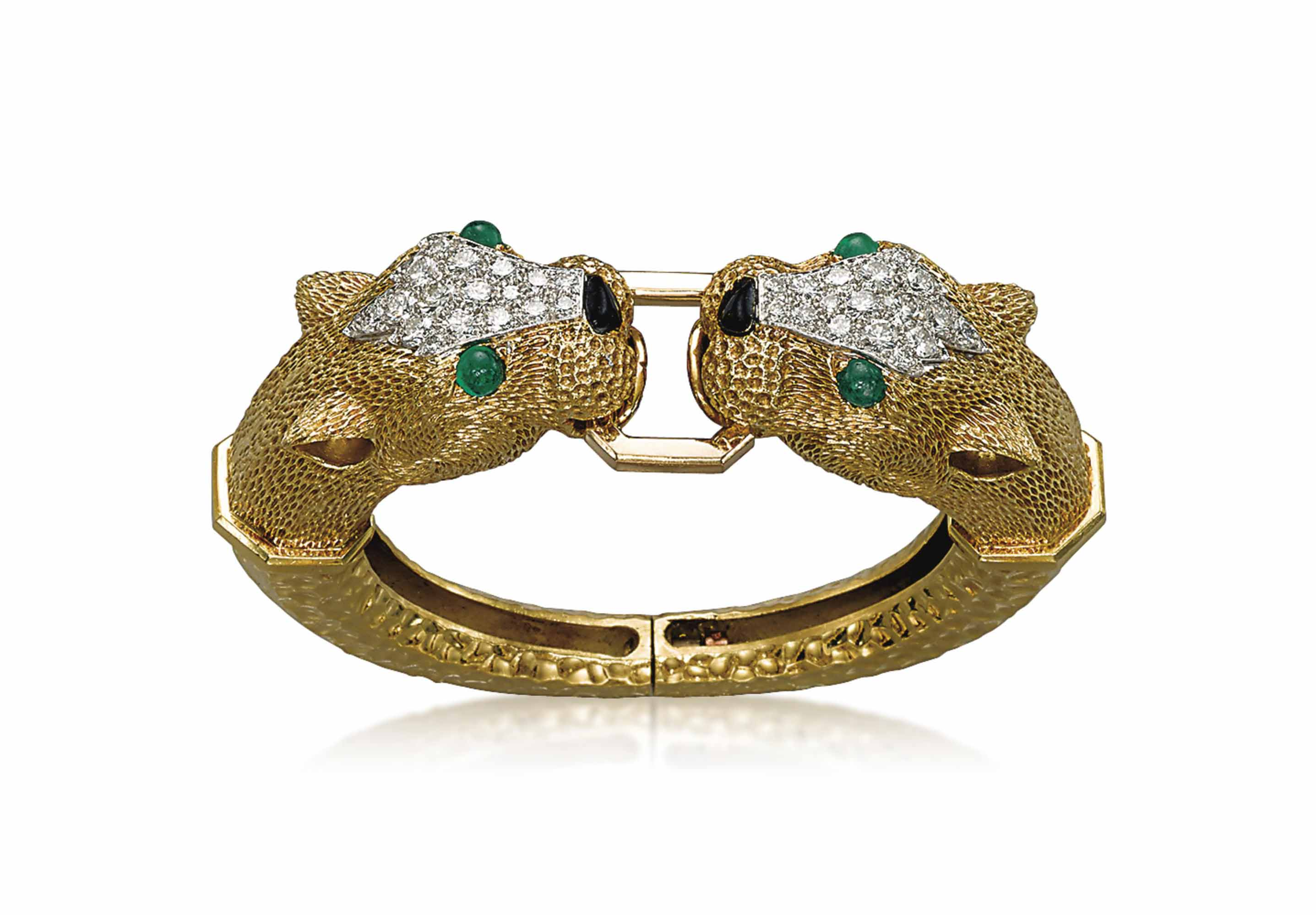 A GOLD, DIAMOND AND EMERALD BANGLE, BY KUTCHINSKY