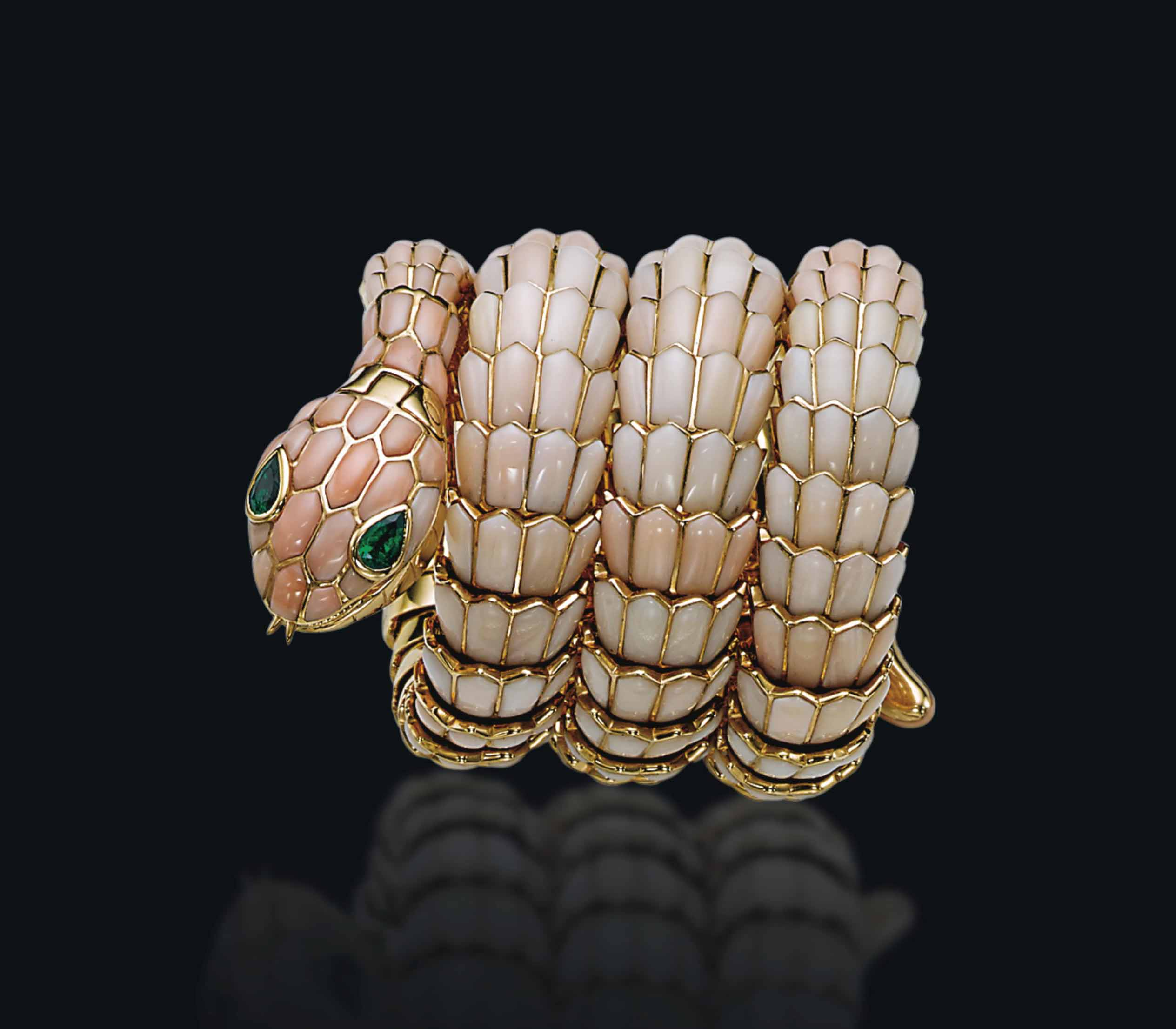 A RARE CORAL AND EMERALD SNAKE WATCH-BRACELET, BY BULGARI