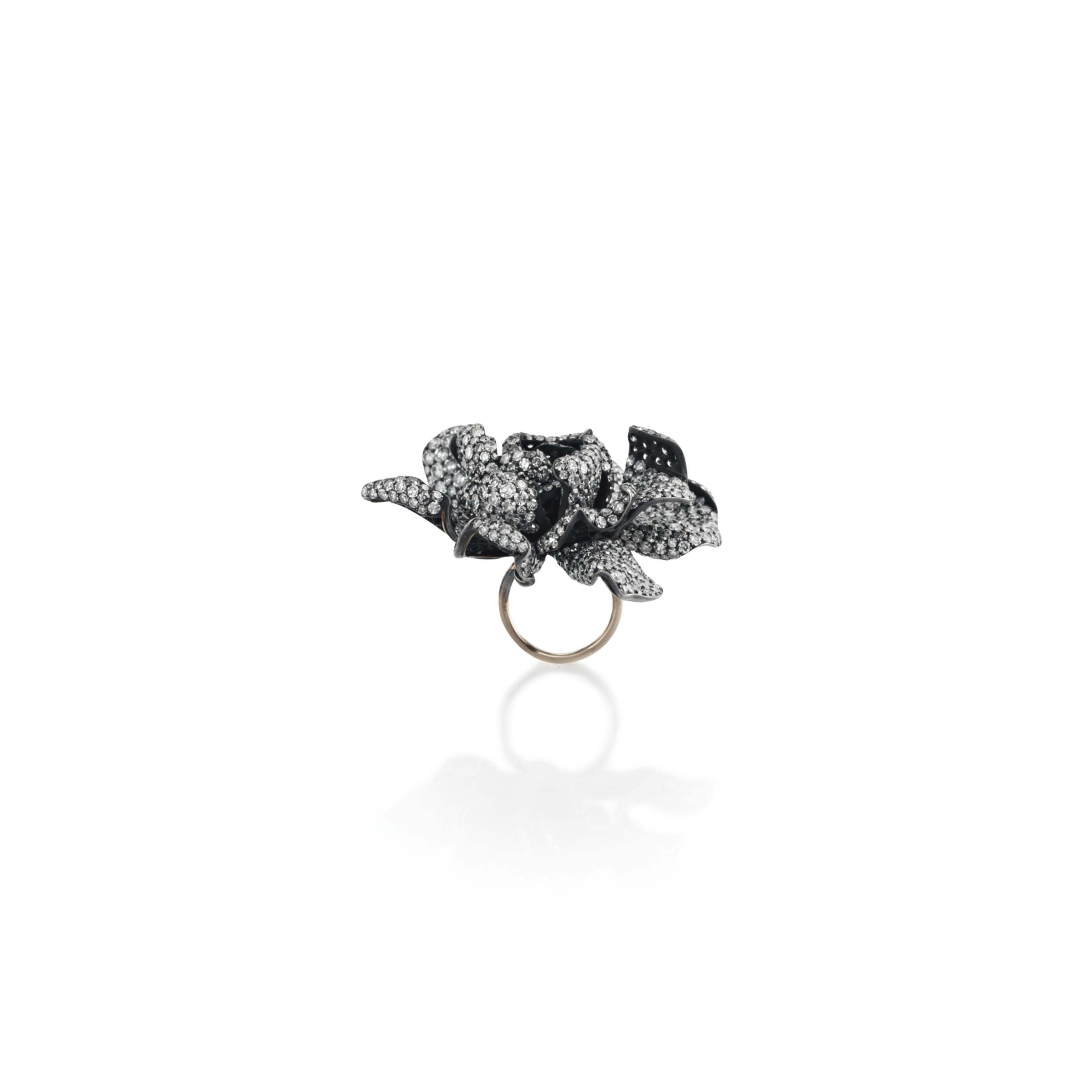A DIAMOND 'GARDENIA' RING, BY