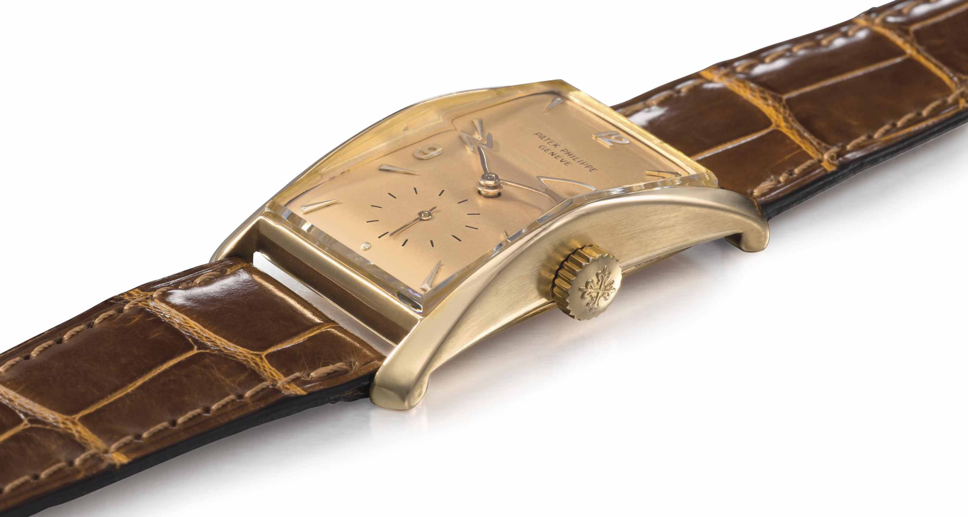 PATEK PHILIPPE. A FINE AND RARE 18K PINK GOLD RECTANGULAR CURVED WRISTWATCH WITH PINK DIAL
