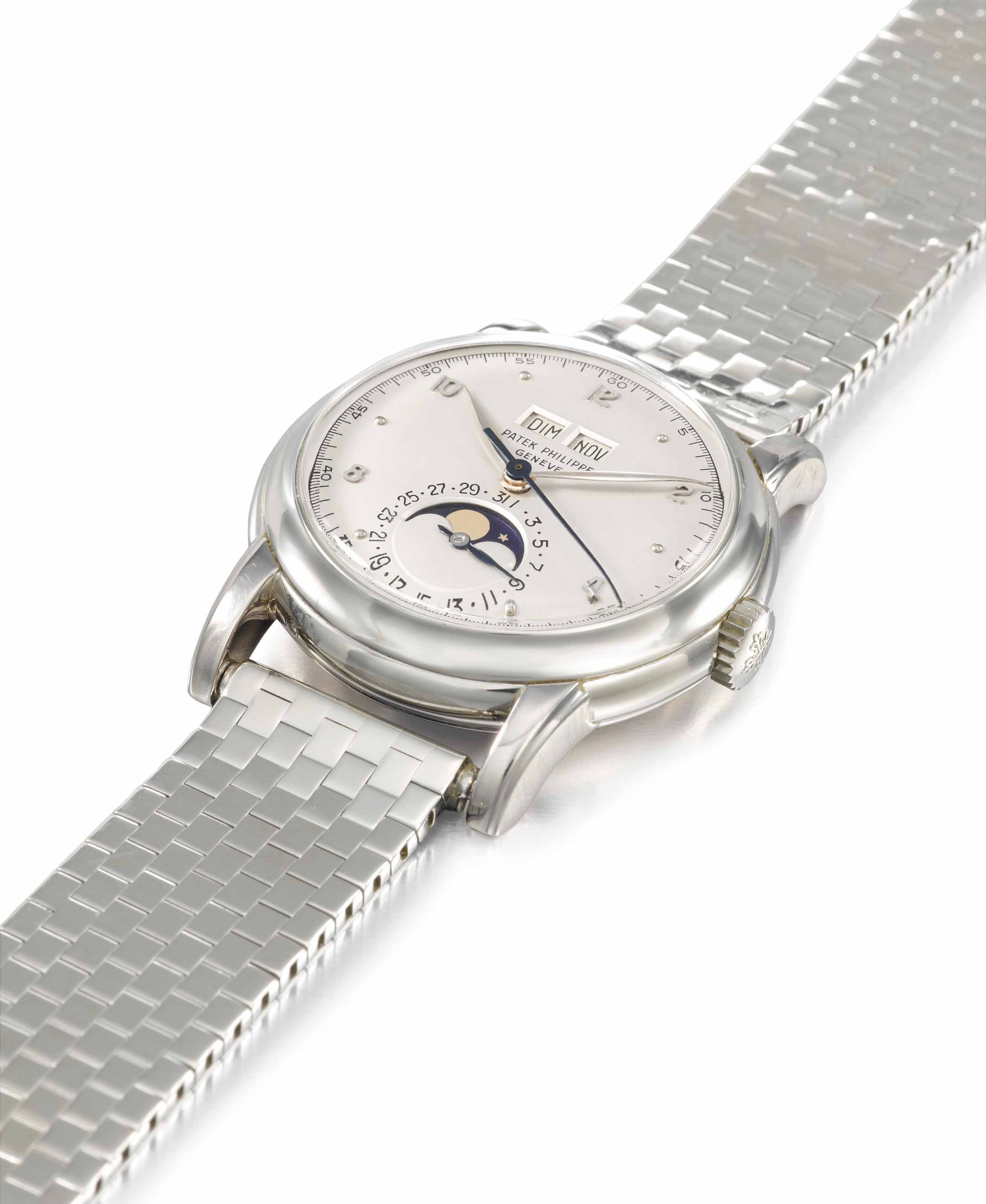 Patek Philippe. An extremely rare and very fine 18K white gold perpetual calendar wristwatch with sweep centre seconds, phases of the moon and bracelet