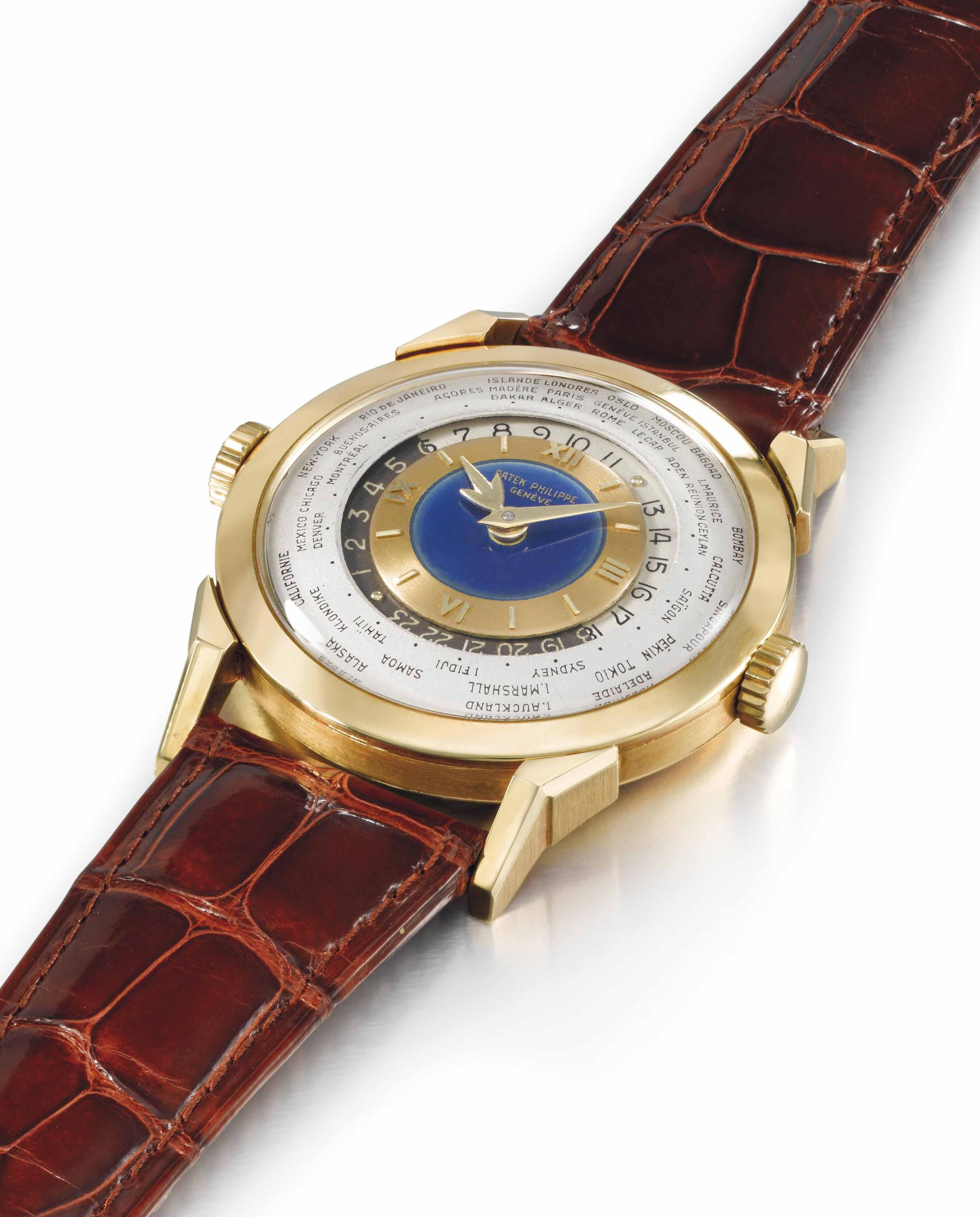 Patek Philippe. An exceptionally rare and highly important 18K gold two crown world time wristwatch with 24 hours indication and blue enamel dial