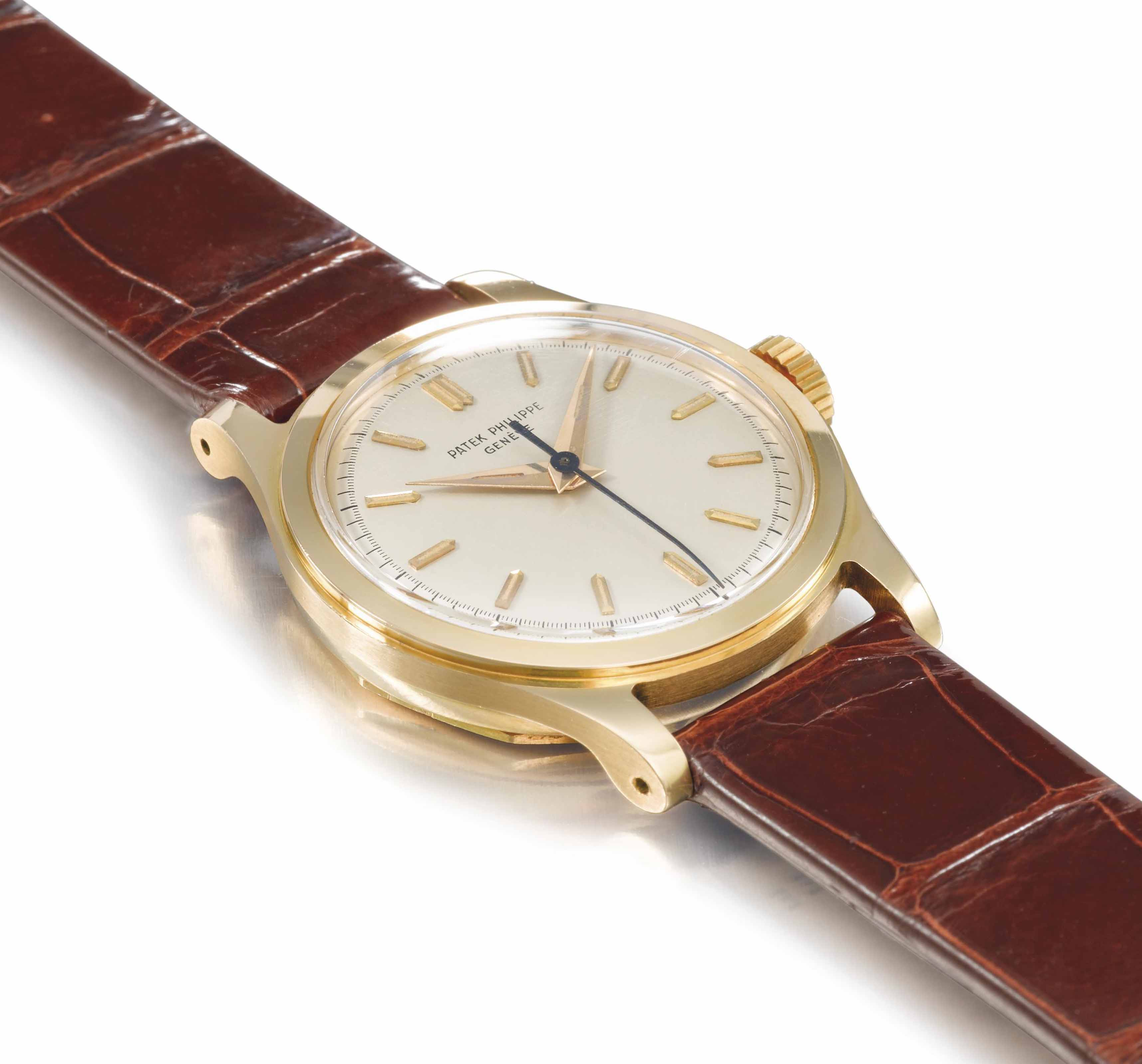 PATEK PHILIPPE. A FINE AND RARE 18K GOLD WRISTWATCH WITH SWEEP CENTRE SECONDS