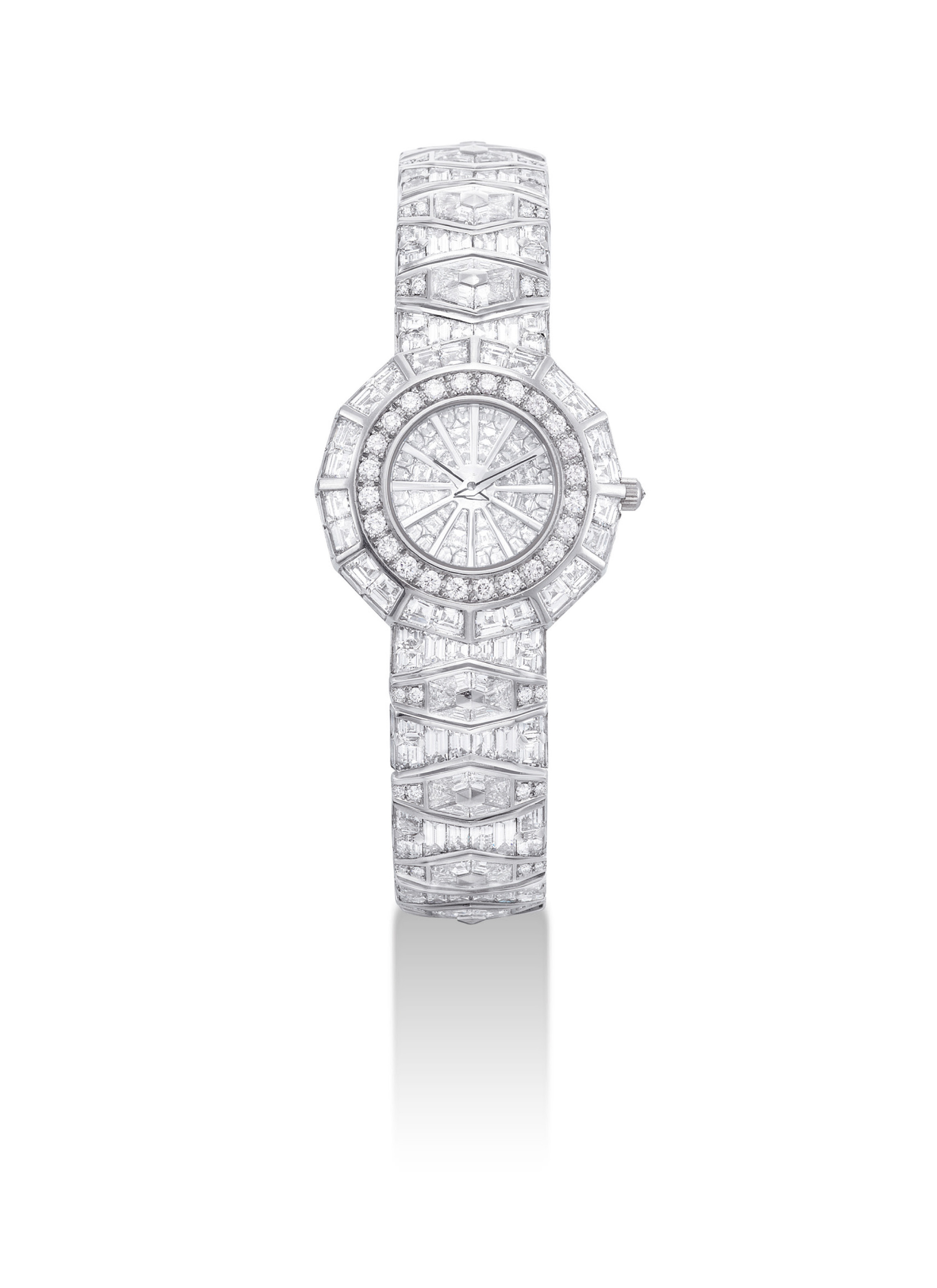CORUM. A LADY'S IMPRESSIVE AND FINE PLATINUM AND DIAMOND-SET DODECAGON-SHAPED BRACELET WATCH